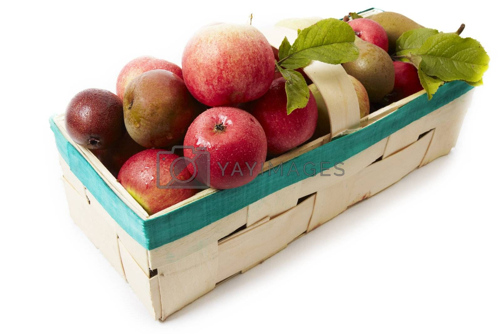 Basket with apple isolated on white background