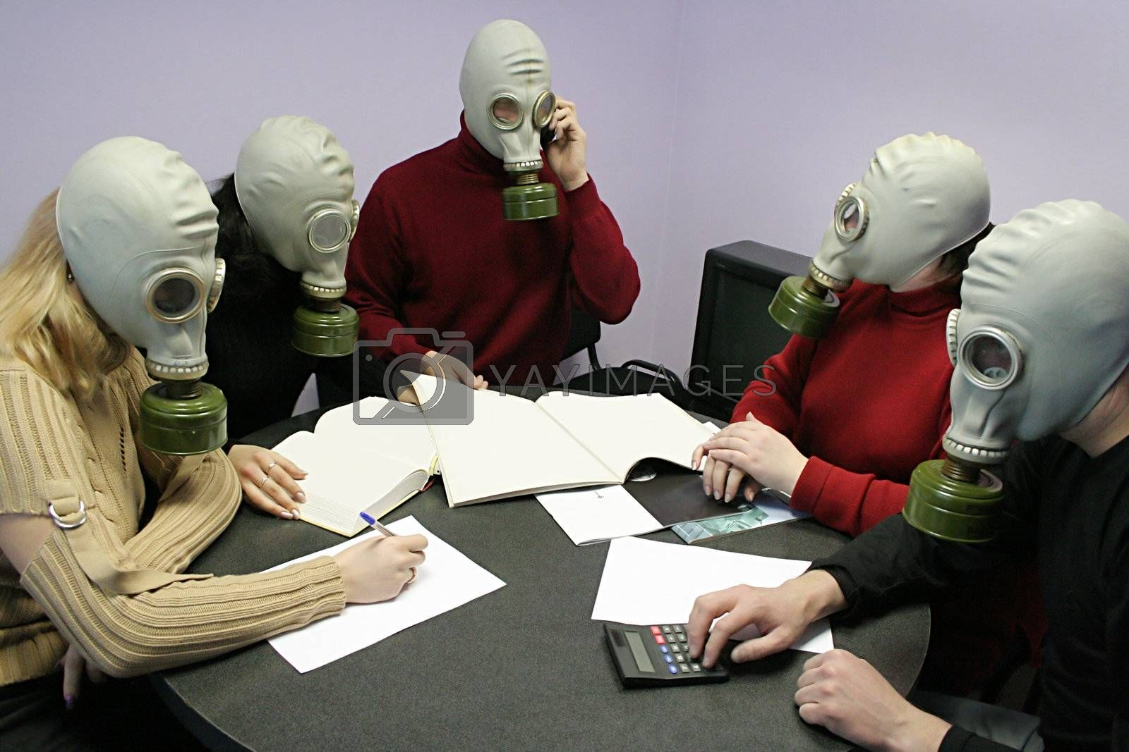 Industrial conference in gas masks behind a table