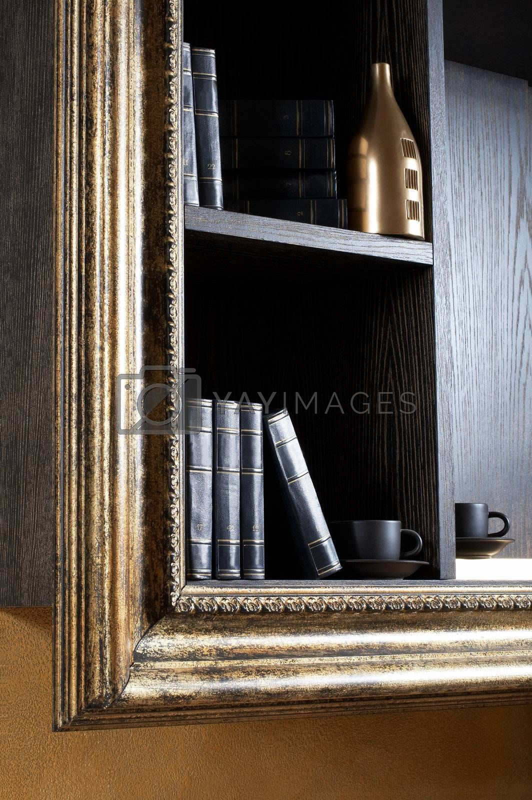 Magnificent shelf with books, cups and a bottle