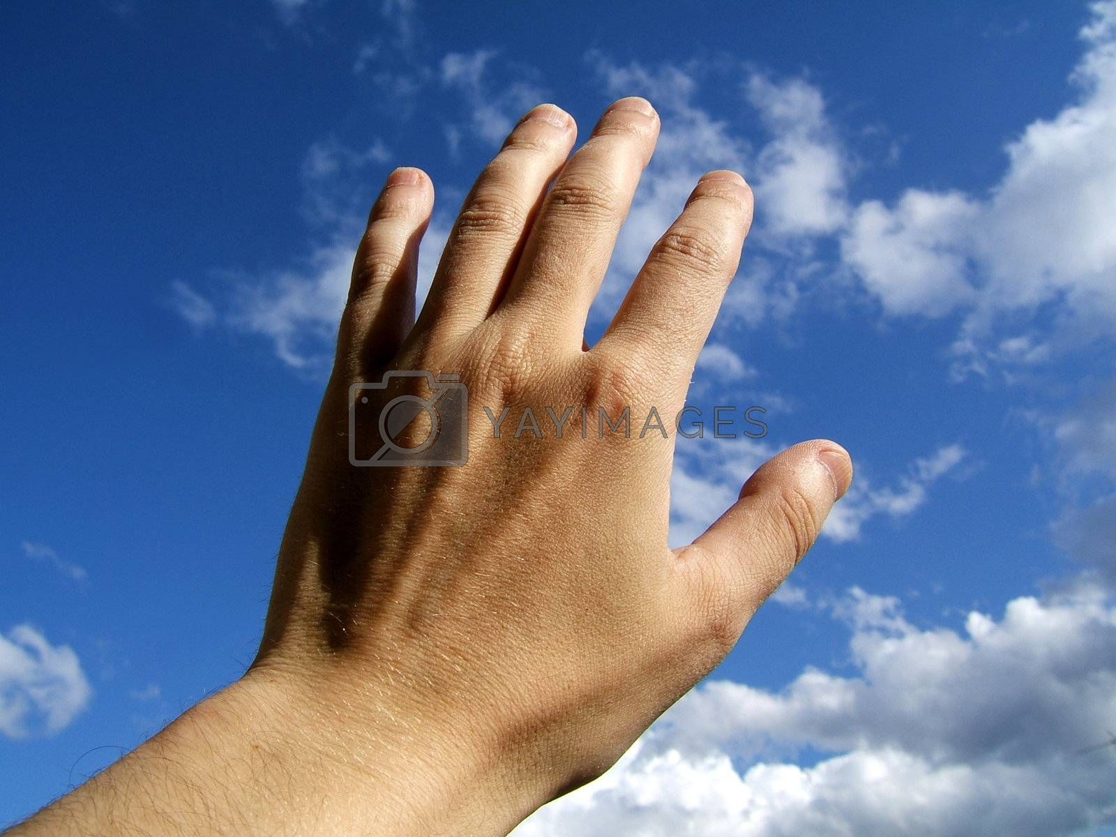 Man hand on sky background
