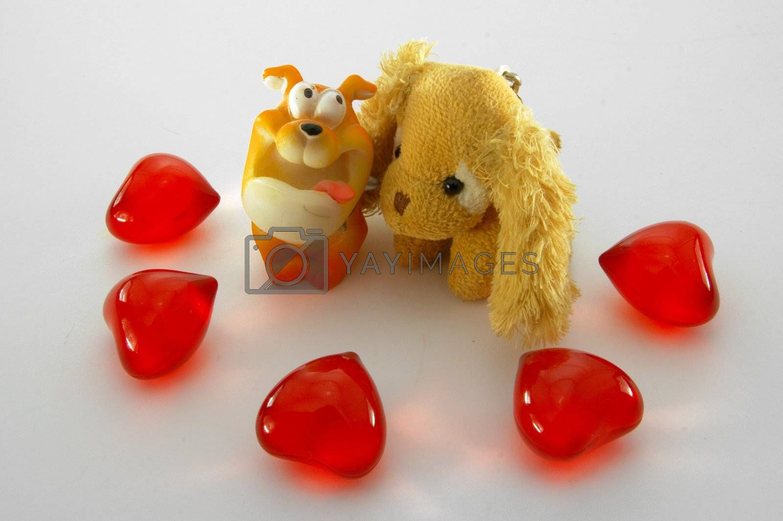 two gogs and red hearts