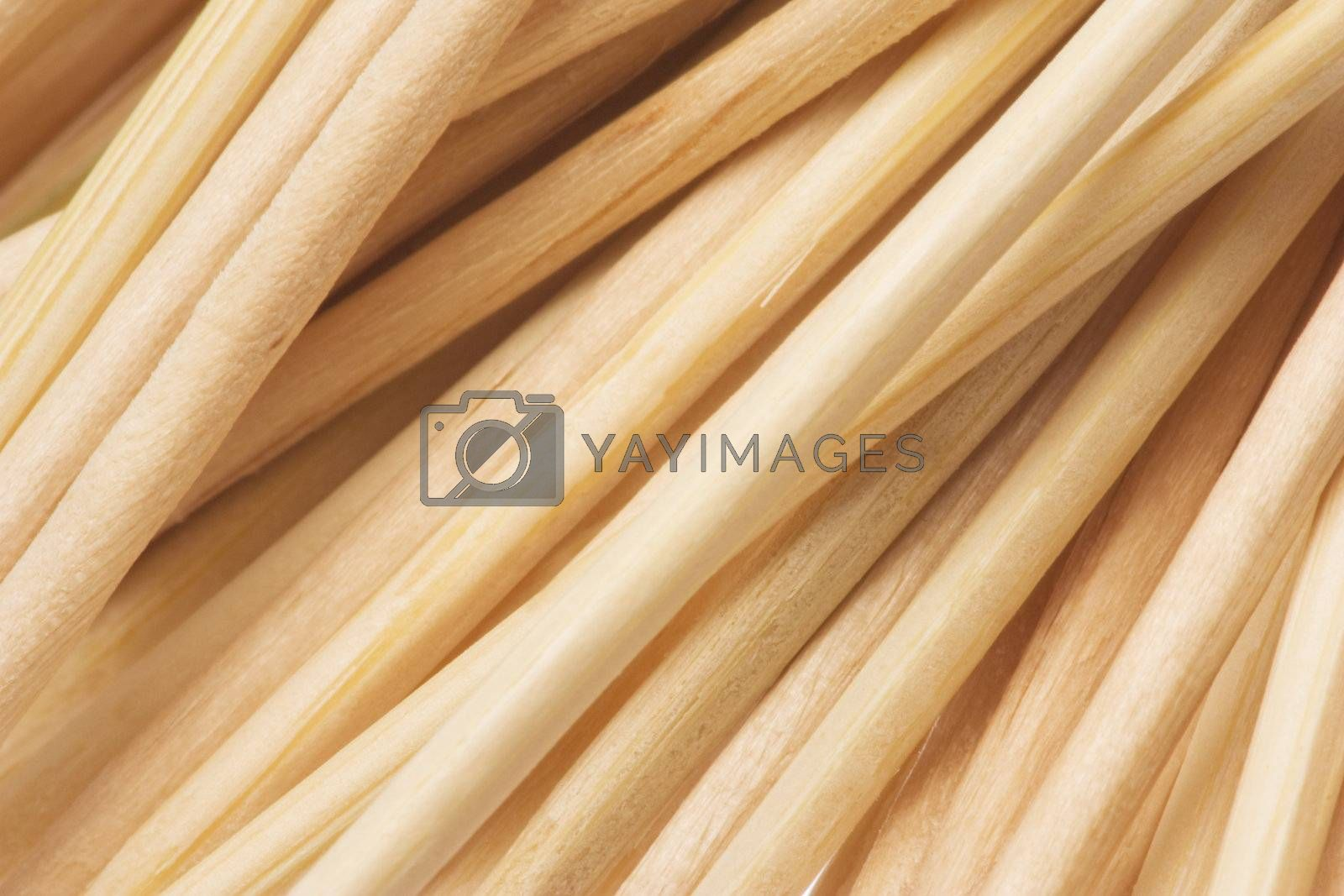 Isolated macro image of wooden toothpicks texture.