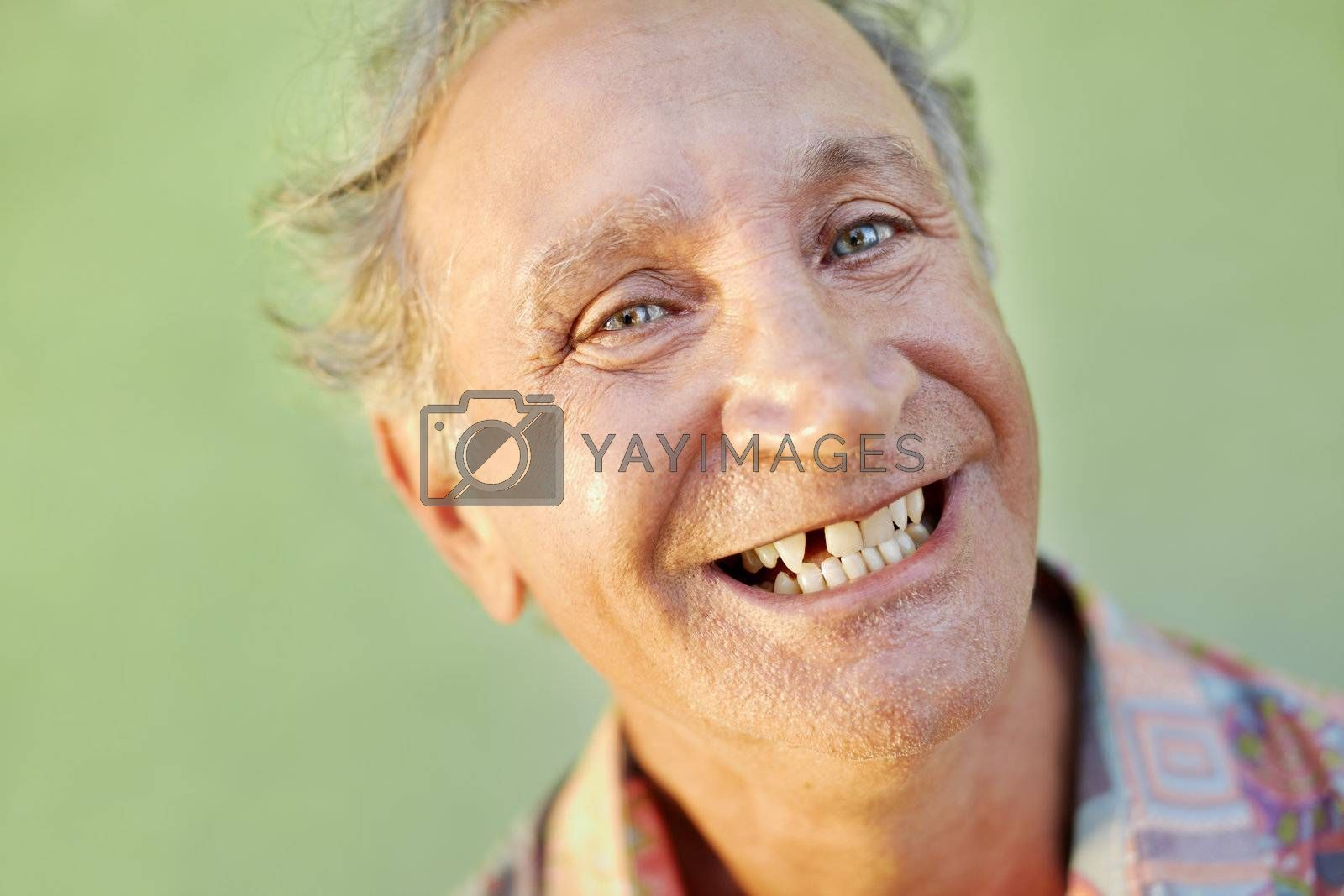 portrait of senior caucasian man with dental problems showing missing tooth and smiling. Horizontal shape, copy space