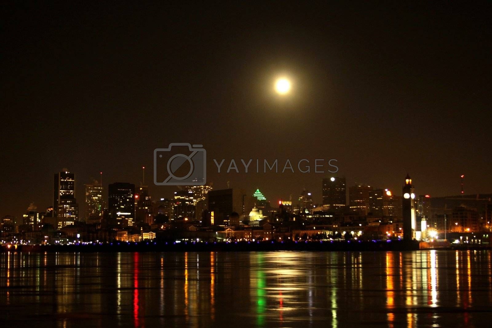 End of night full moon over Montreal cityscape