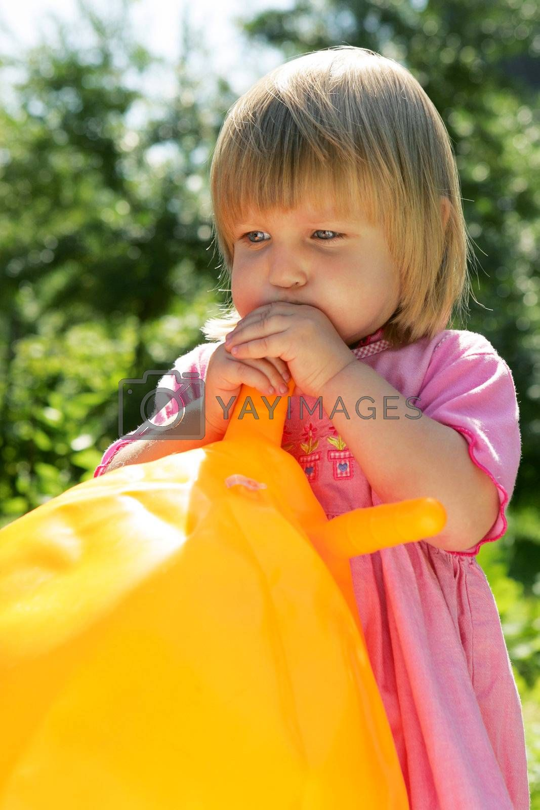 The girl inflates a ball