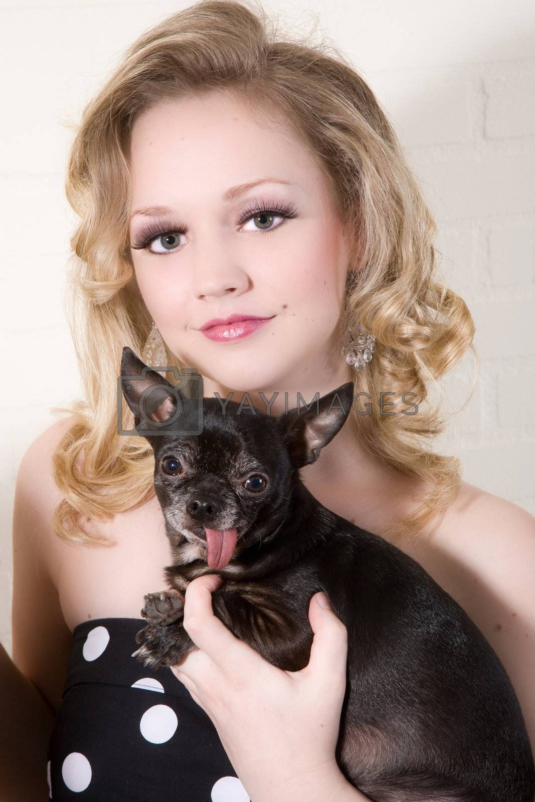 Blond beautiful woman with her little dog