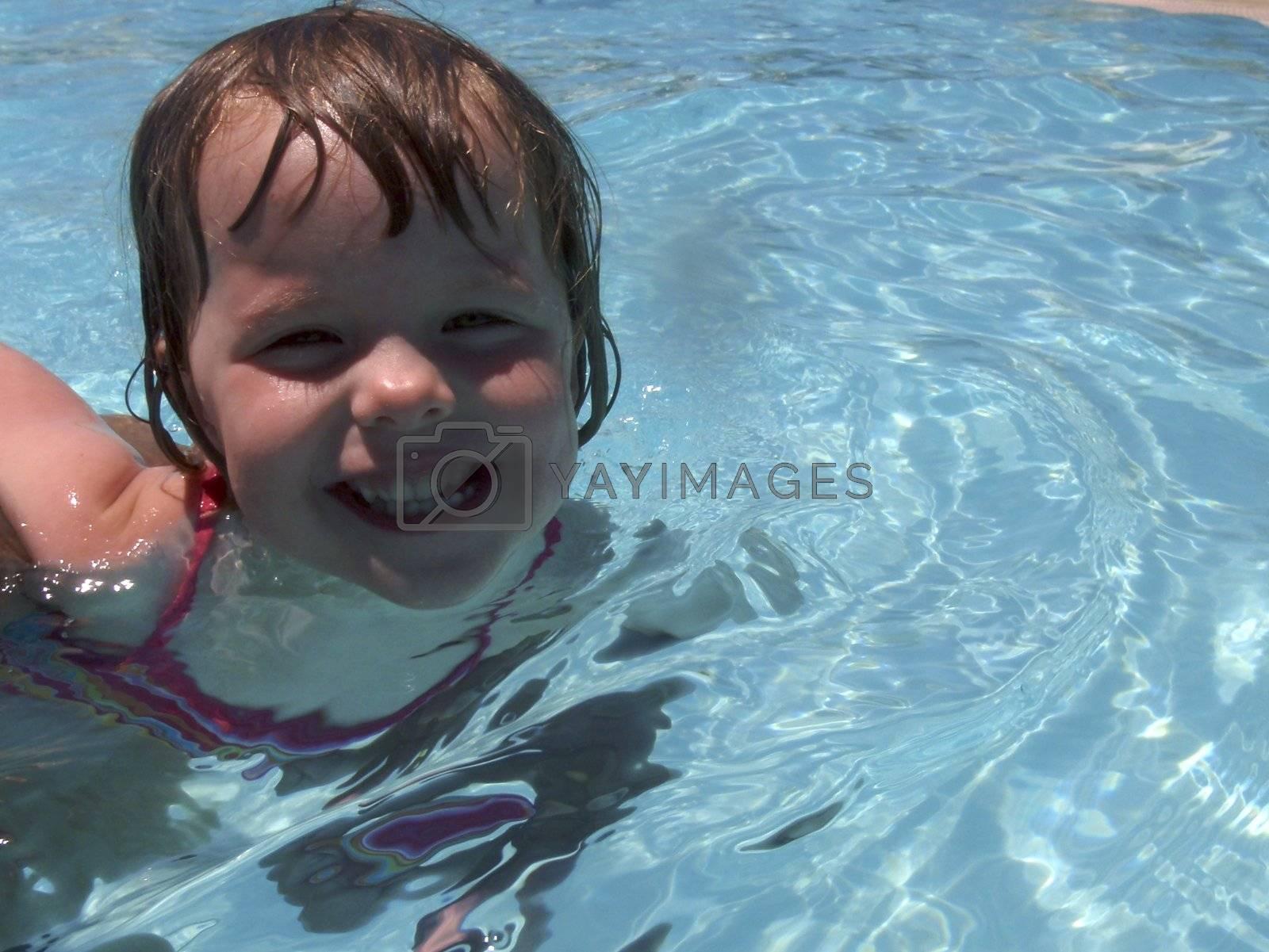 Little girl playing at neighborhood pool