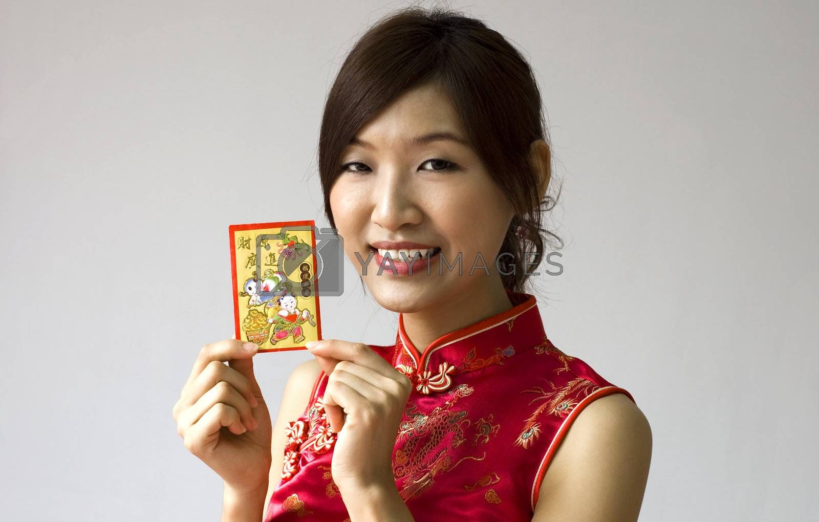 Asian female holding a red packet wishing you happy Chinese New Year