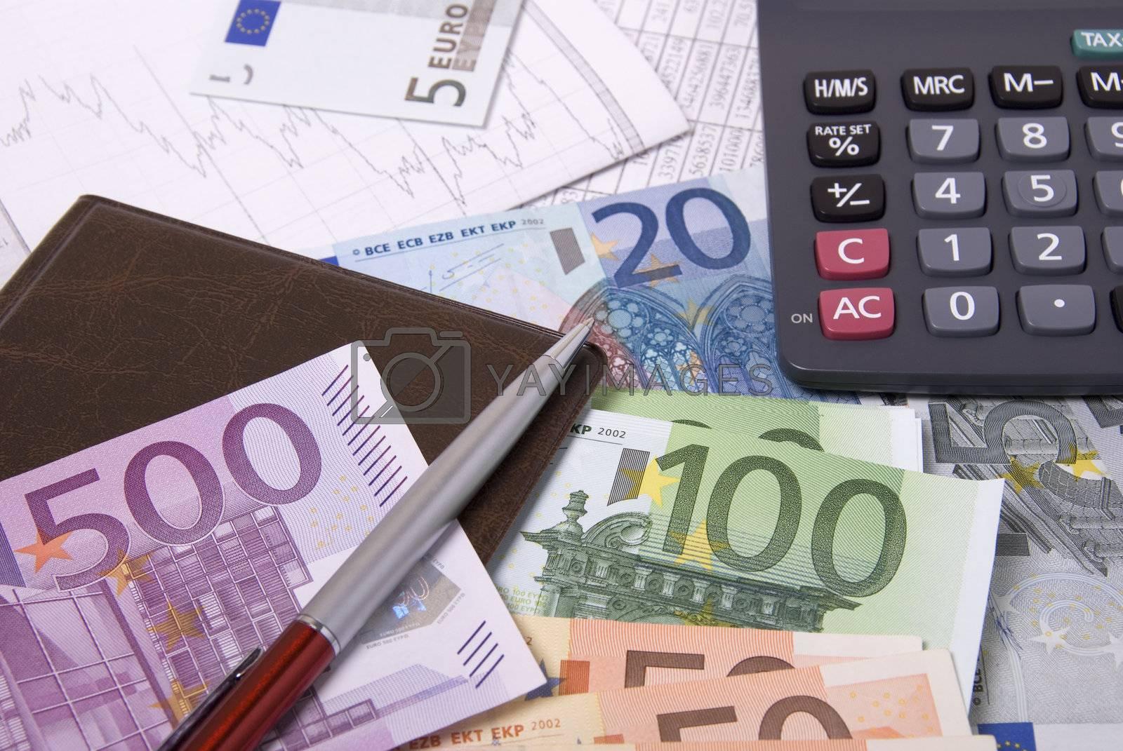 Paper money euro banknotes calculator and pen