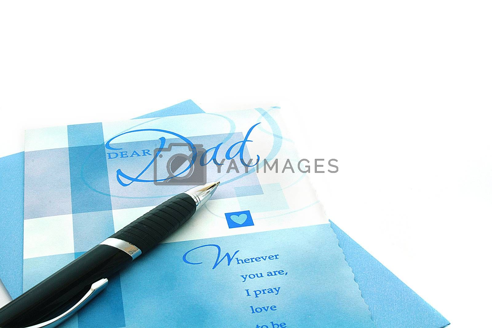 The black pen against congratulatory cards to Father day.