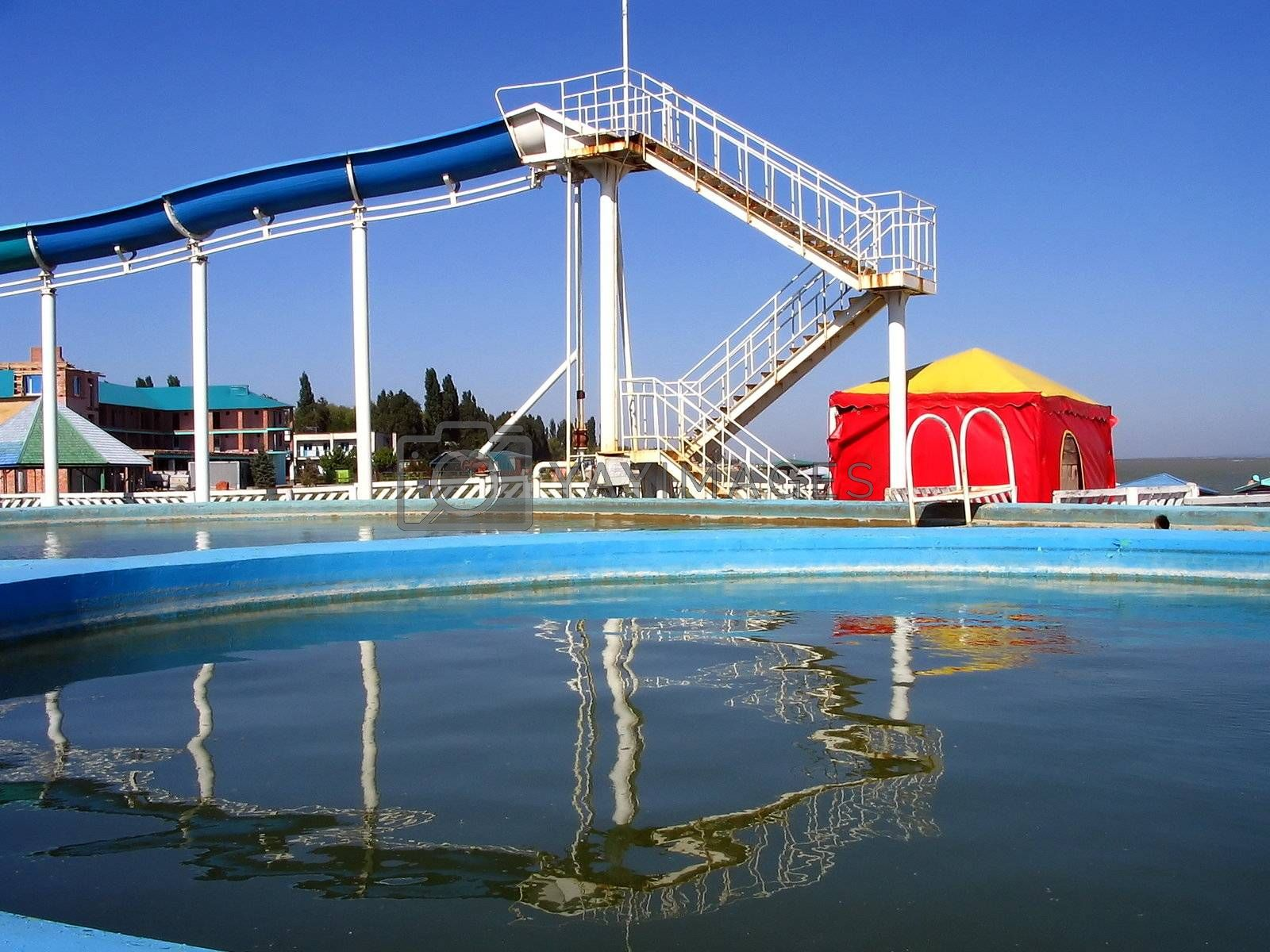 Swimming-pool and childrens  chute on seaside