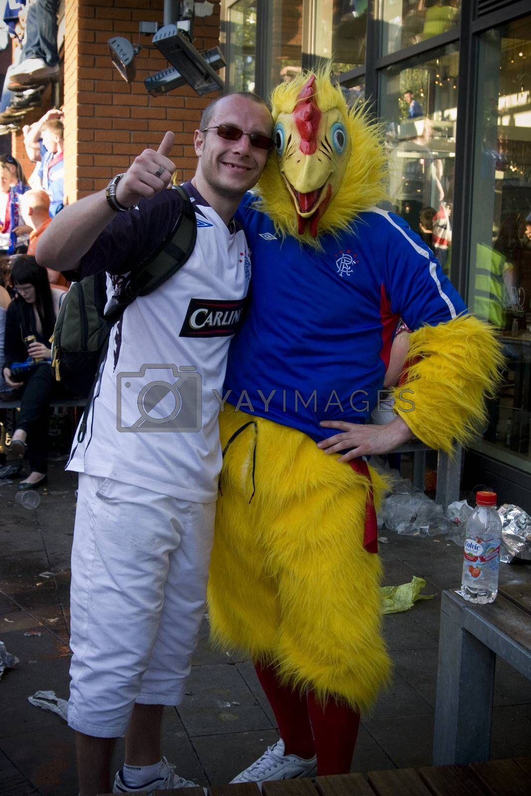 Football chicken mascotte for the UEFA football cup with the Glasgow rangers against St Petersburg,zenit  Piccadilly gardens, Manchester,uk