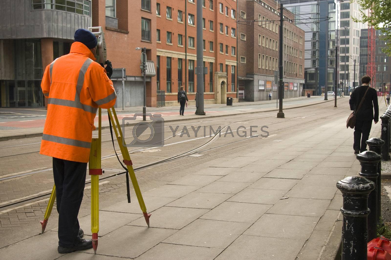 Surveyor taking measure in Manchester, UK