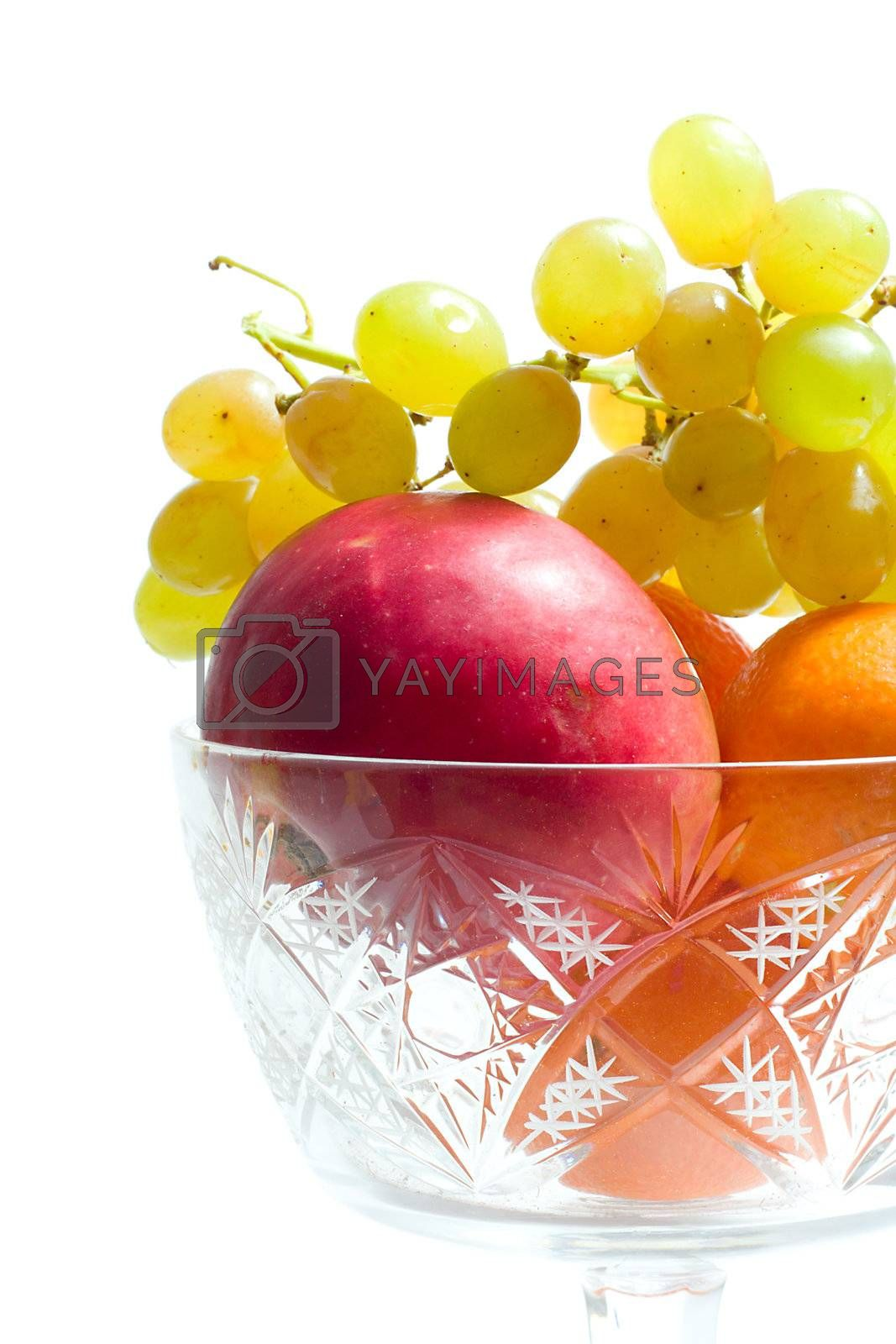 close-up many fruits in bowl, isolated on white