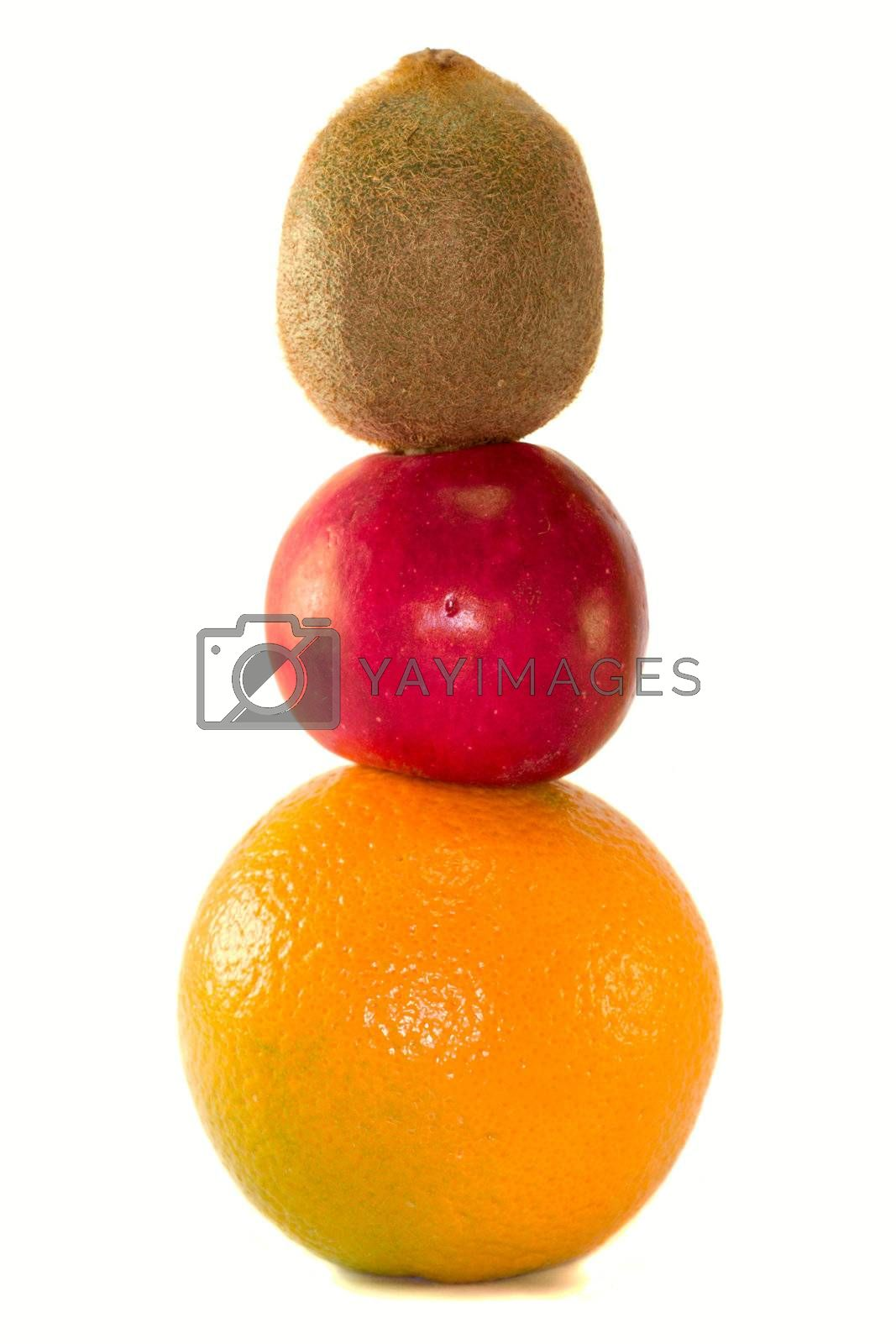 fruits pyramid from kiwi, apple and orange, isolated on white
