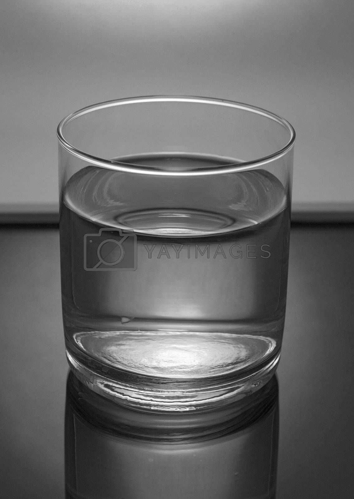 glass of water in mirror table, grayscale