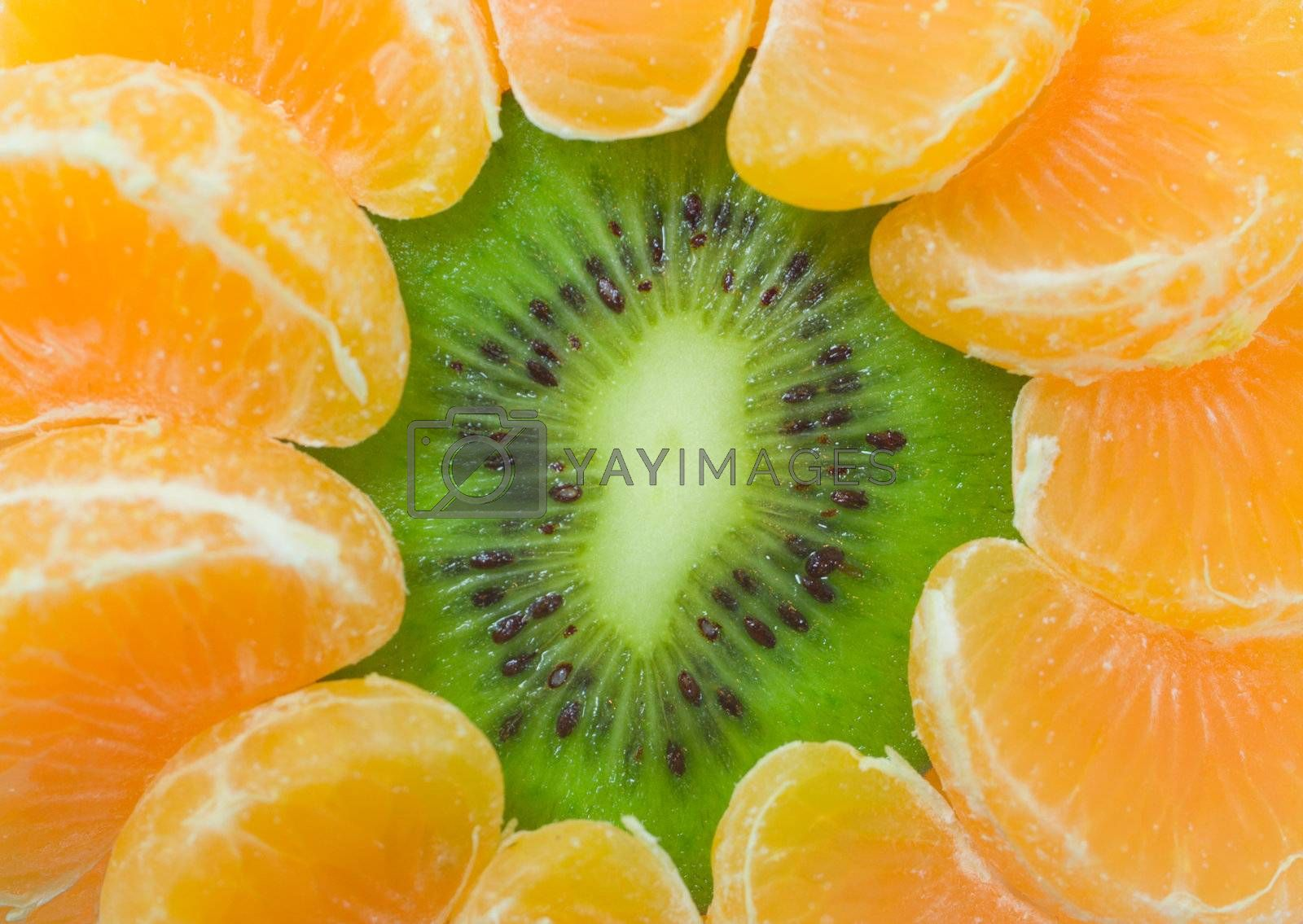 close-up kiwi and tangerine slices as flower