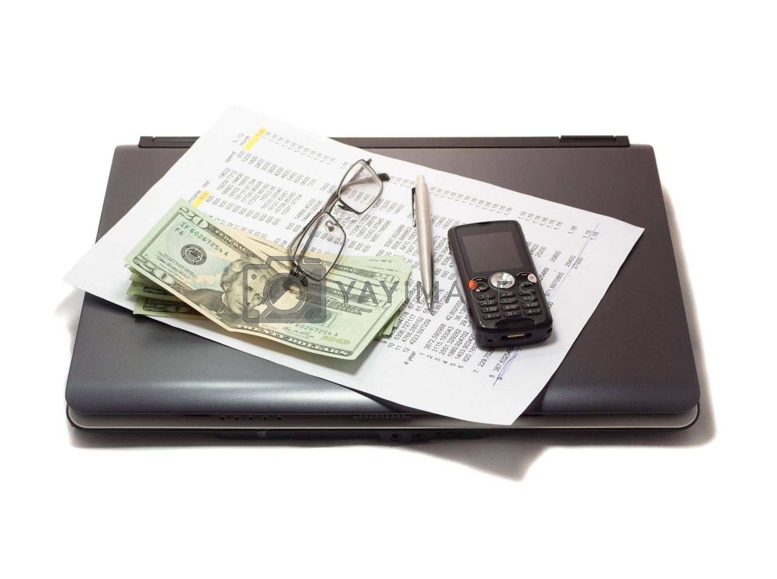 Closed notebook and credit history list with money, glass, pen and mobile phone
