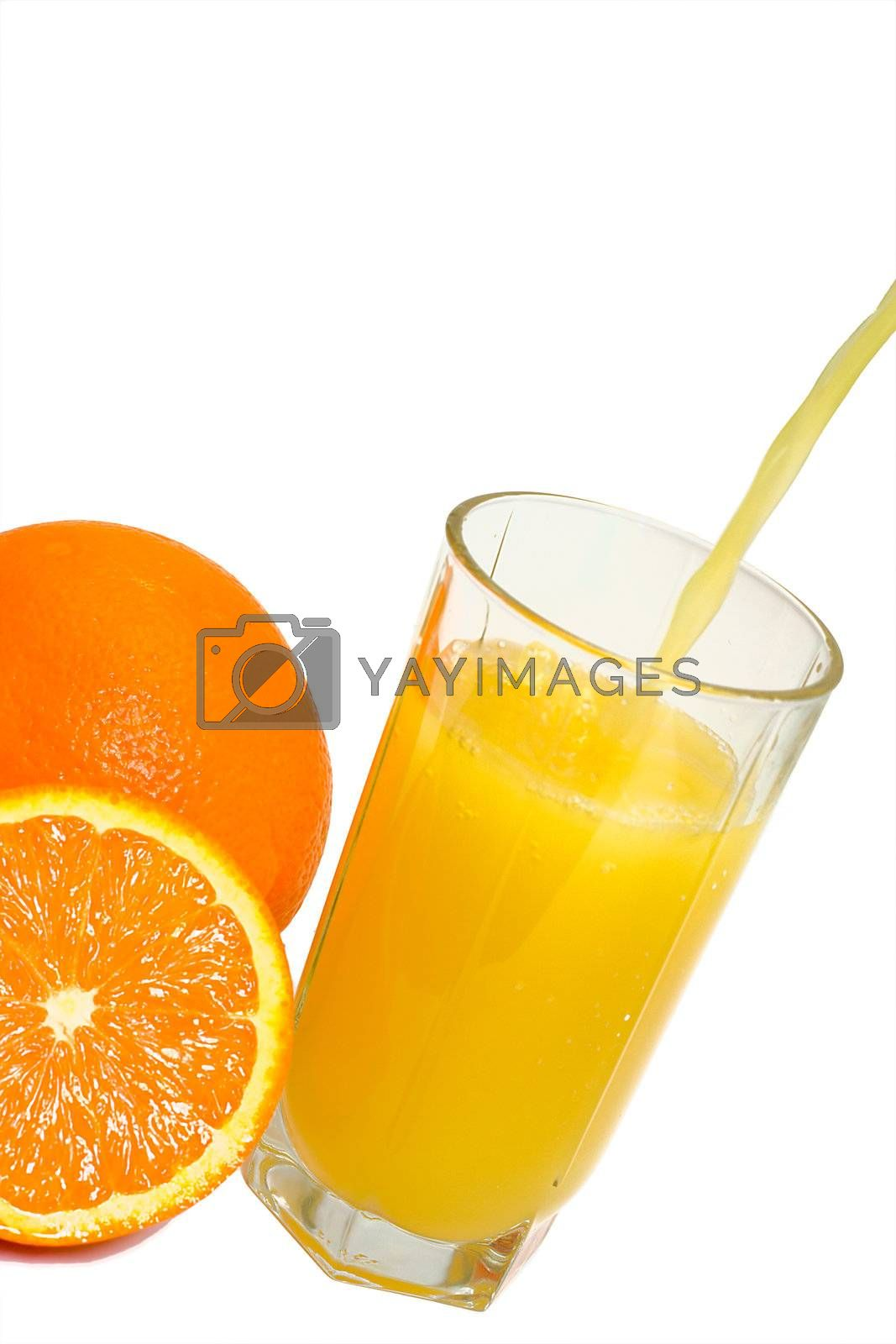 oranges and glass filling with juice, isolated on white