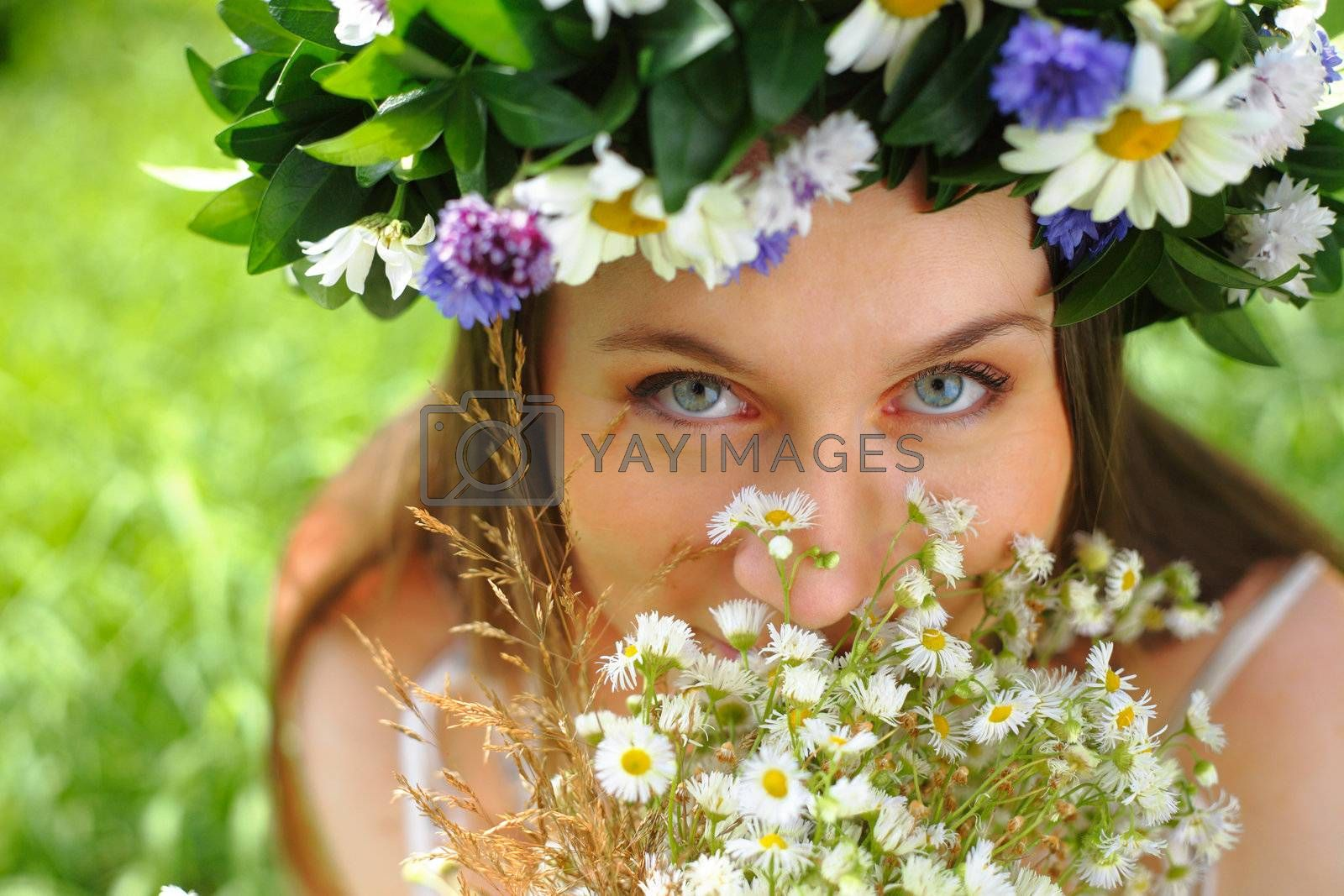 Portrait of a girl with circlet of flowers