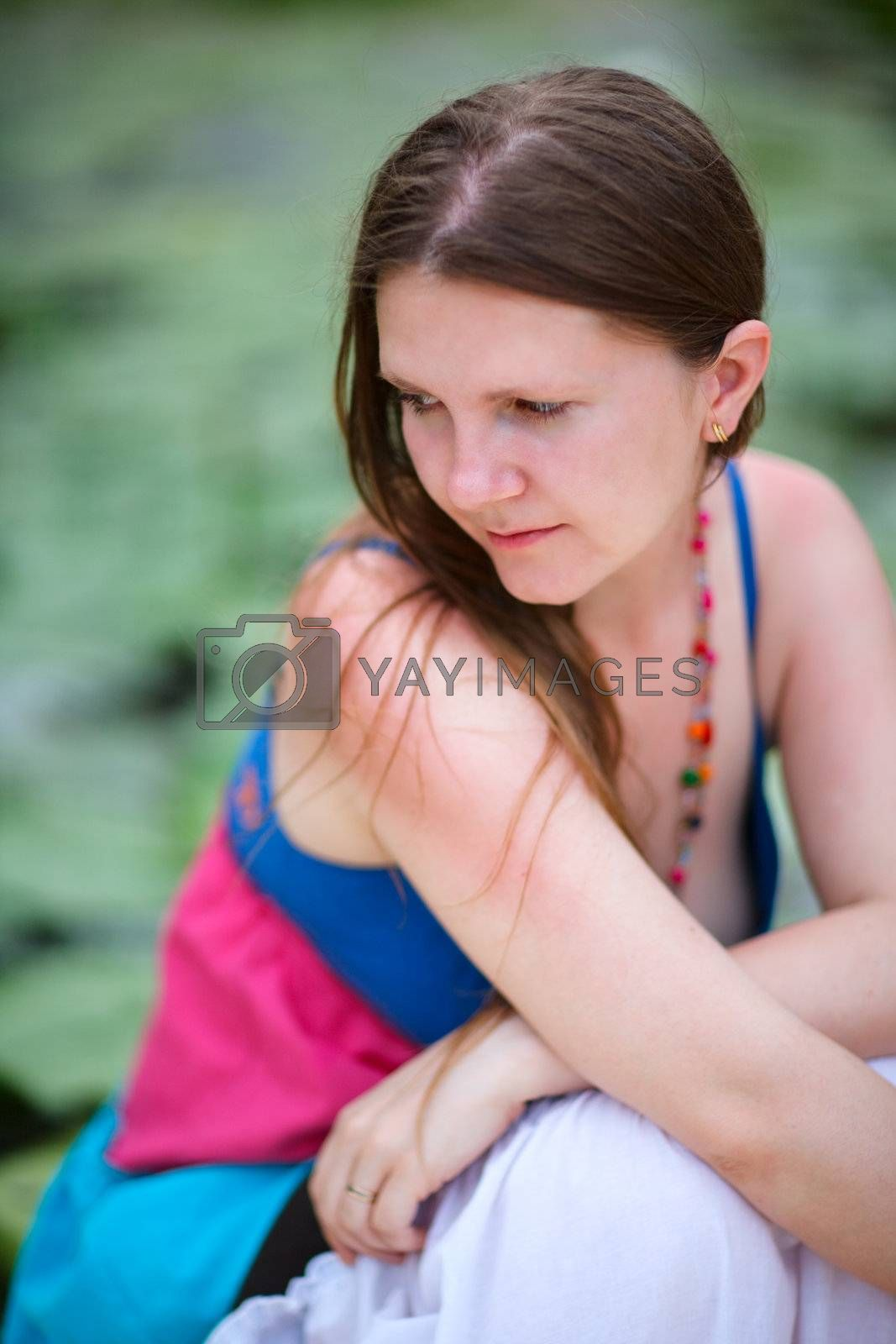 Lifestyle portrait of young beautiful woman outdoors