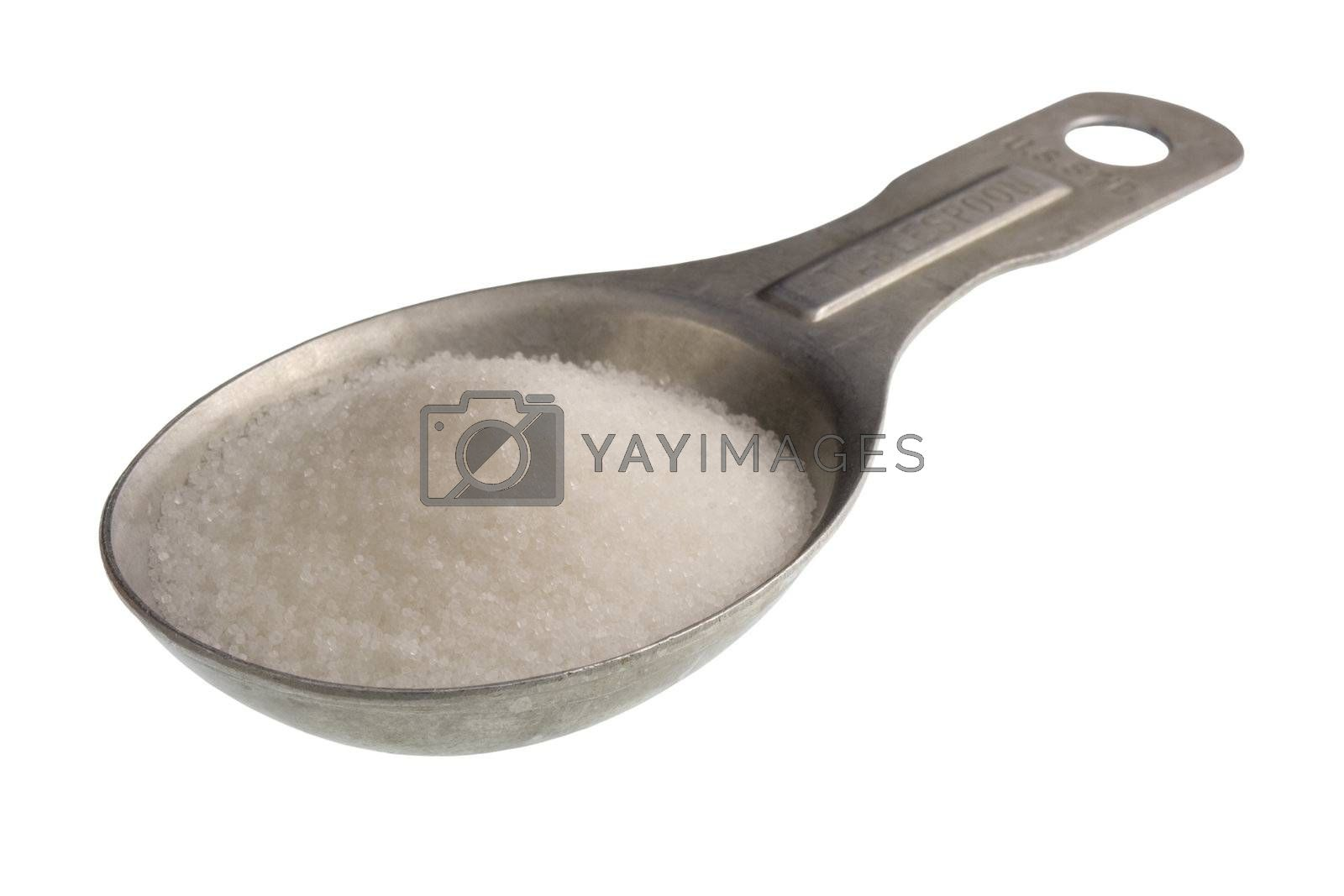old aluminum measuring spoon full of salt isoalted on white, clipping path included