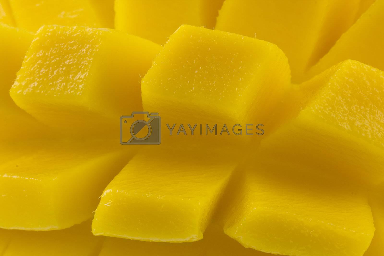 macro of freshly sliced mango fruit ready to eat