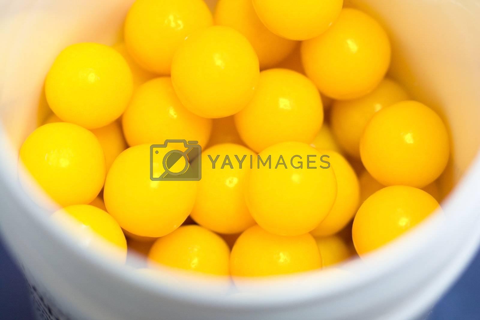 gallipot with vitamin pills, focused on pills
