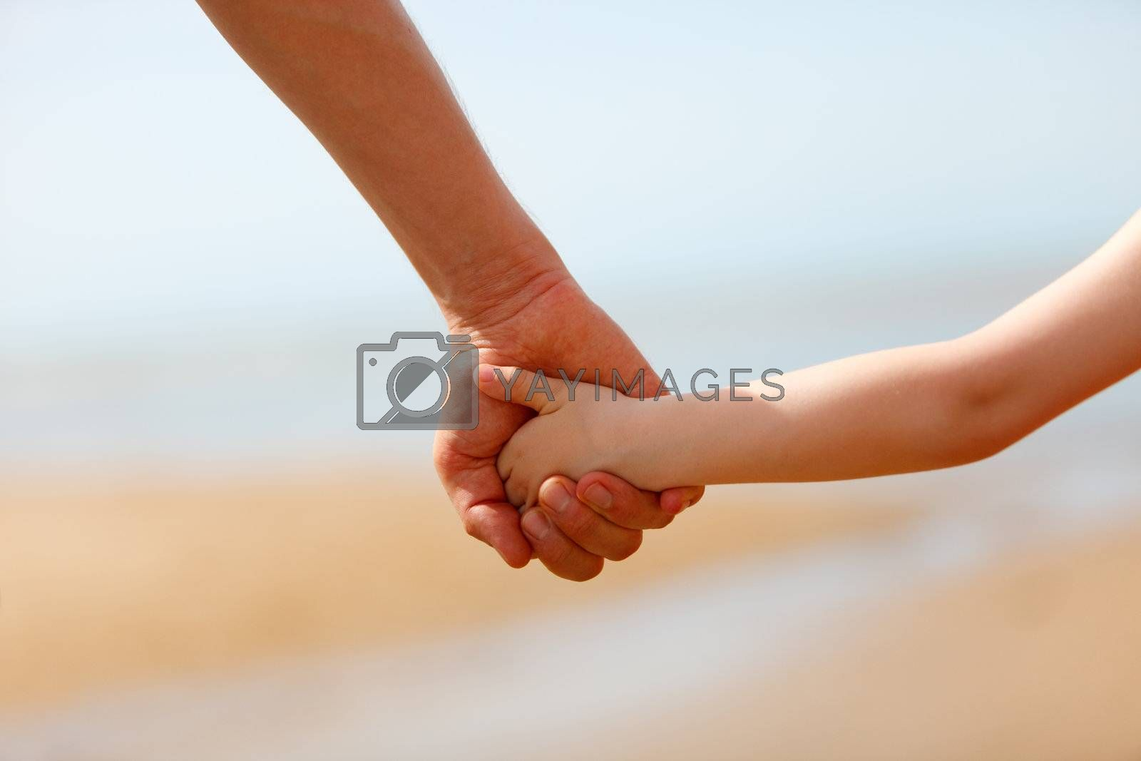Father and son hands by shalamov