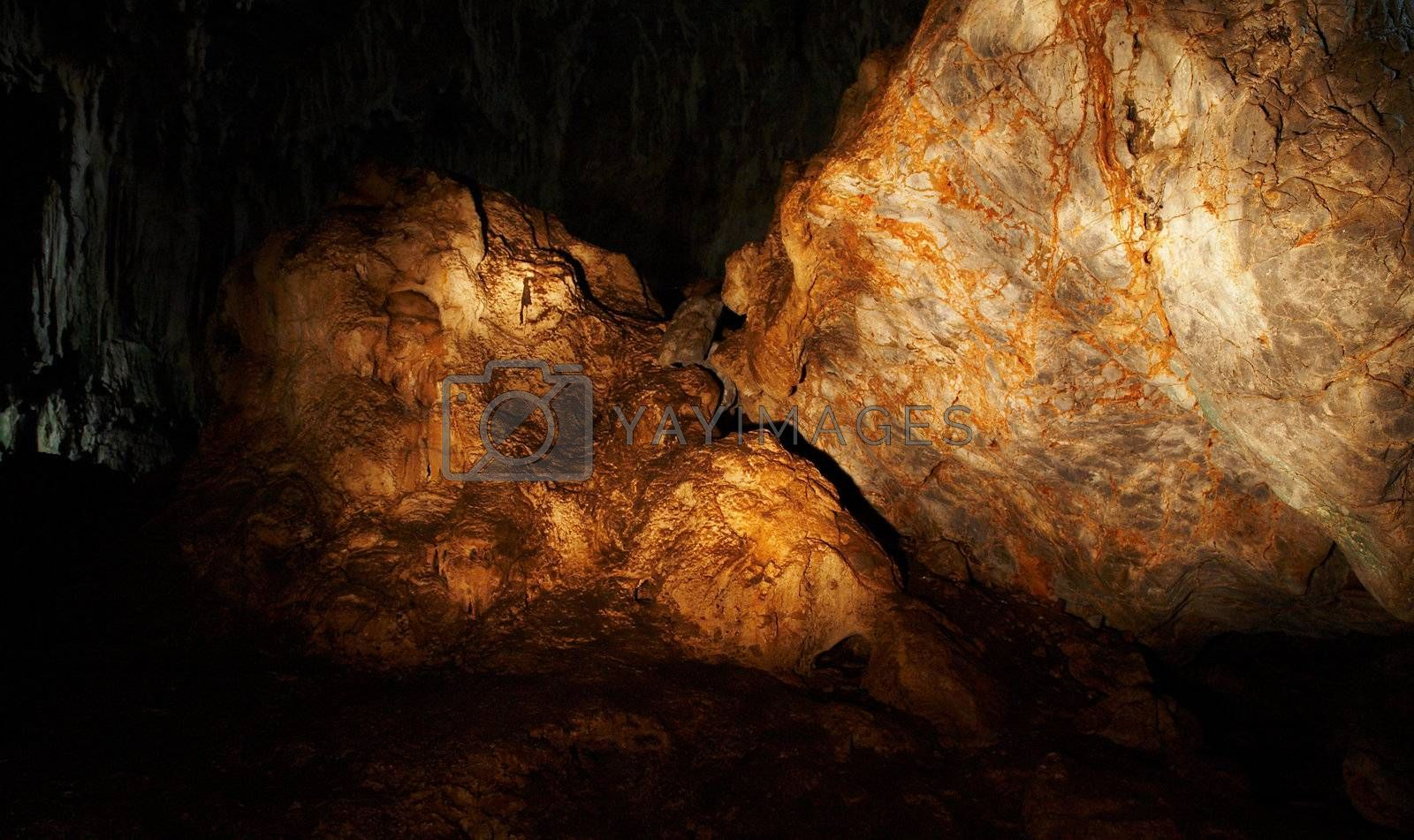 The amber rock in a cave by DeusNoxious