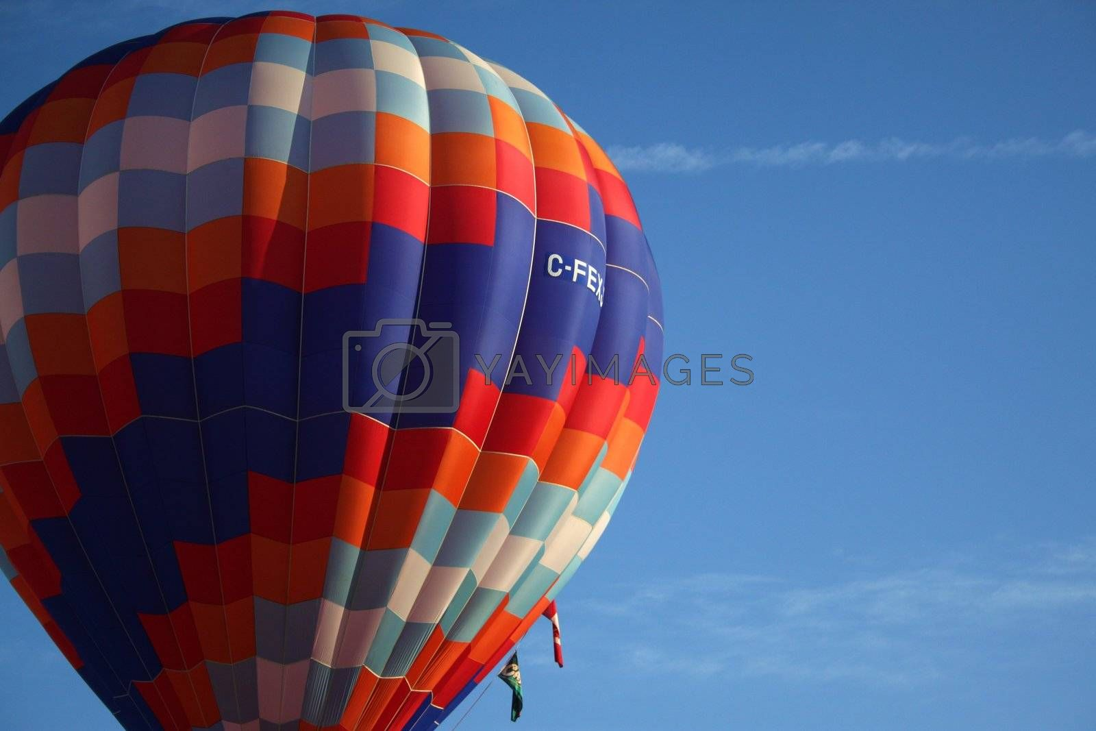 Blue orange and white hot air balloon offset to the left