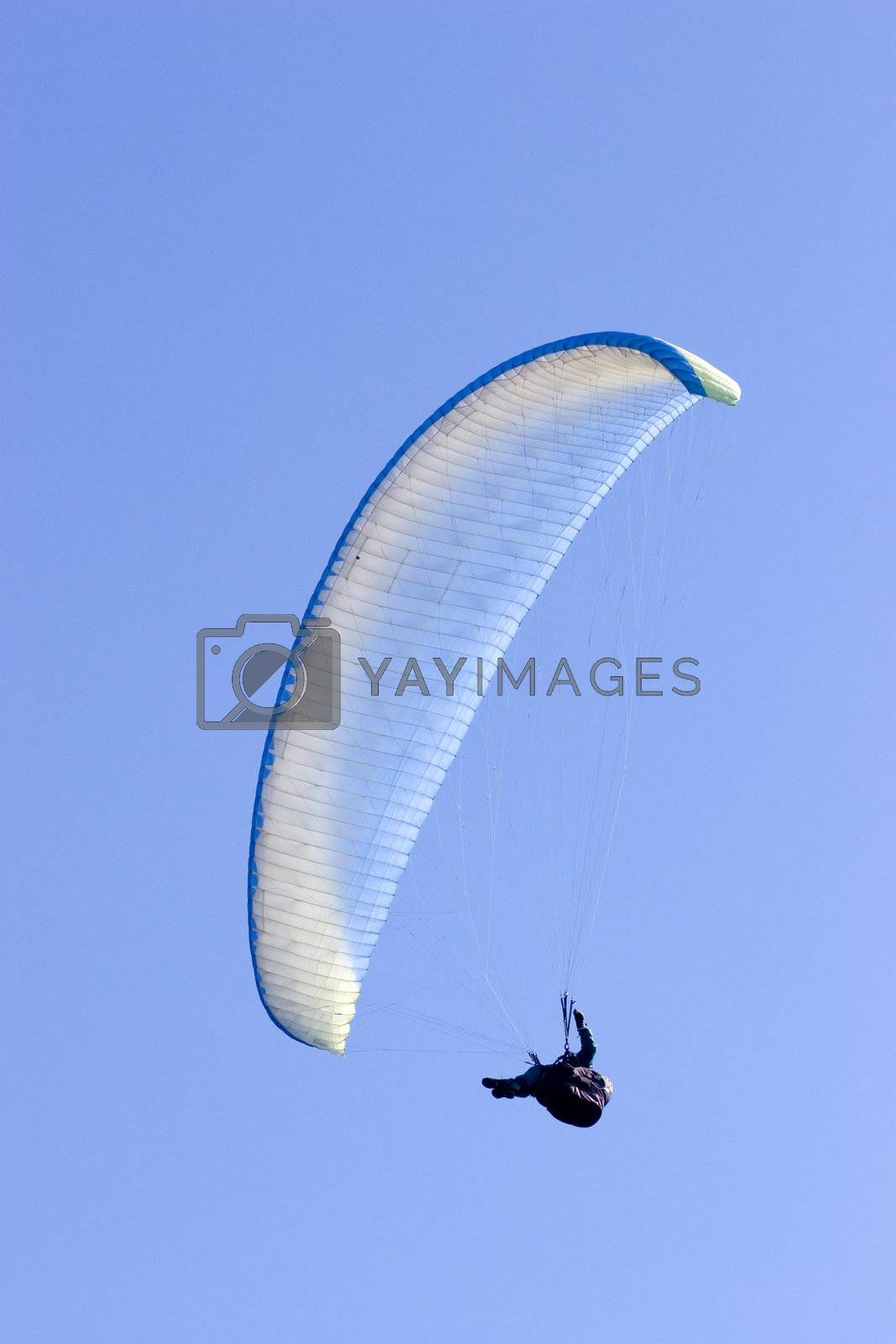 Paraglider in a clear blue sky