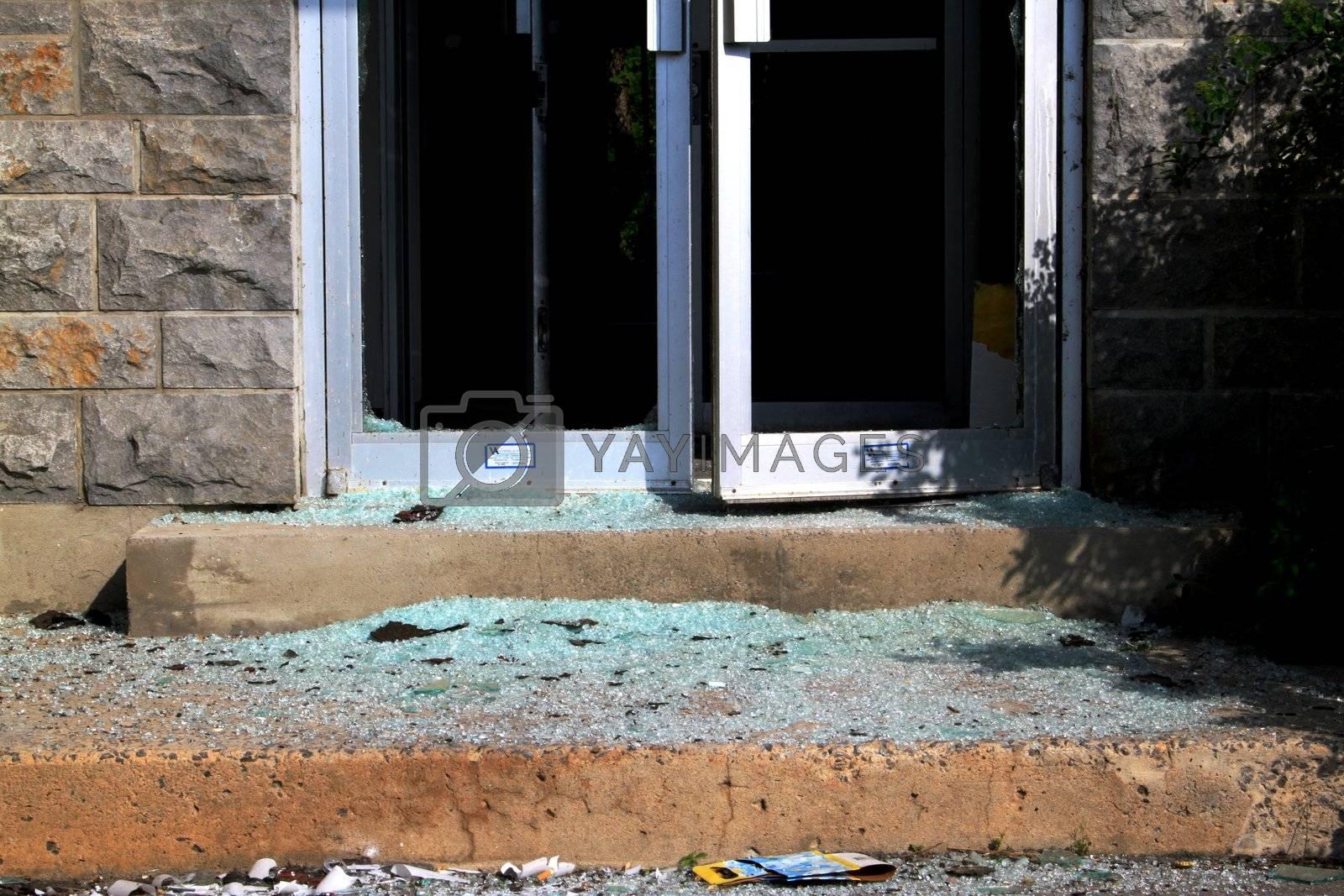 Broken glass doors by vandalism on historic building