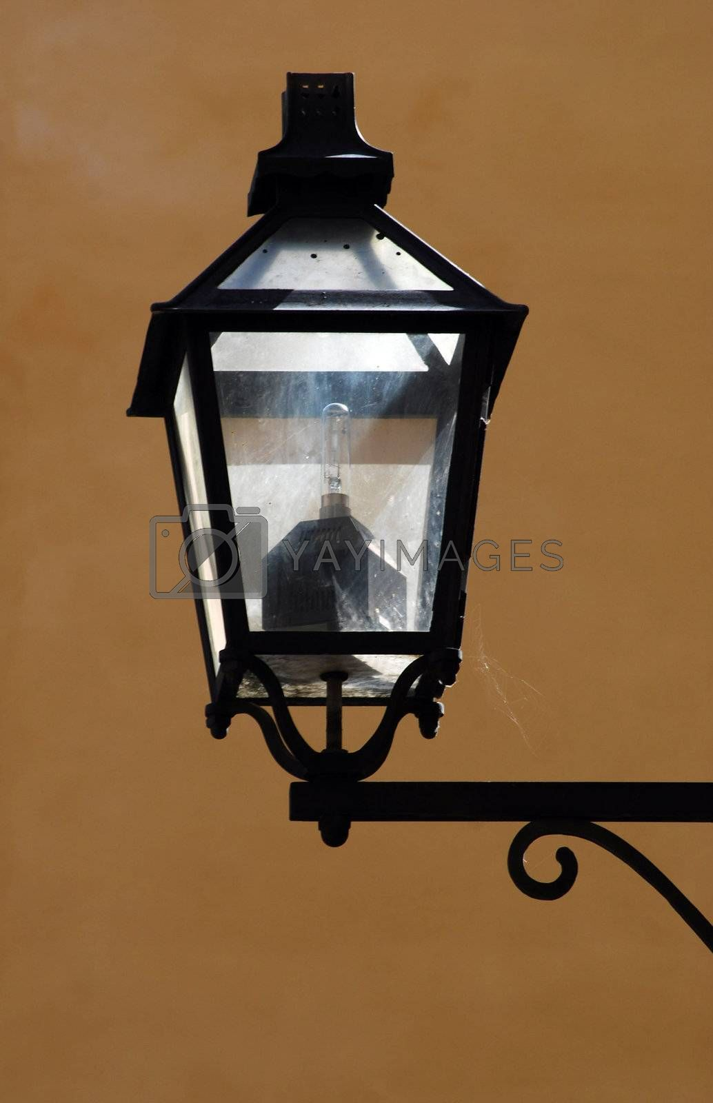 streetlamp with spidernet and reflections in gamla stan Stockholm