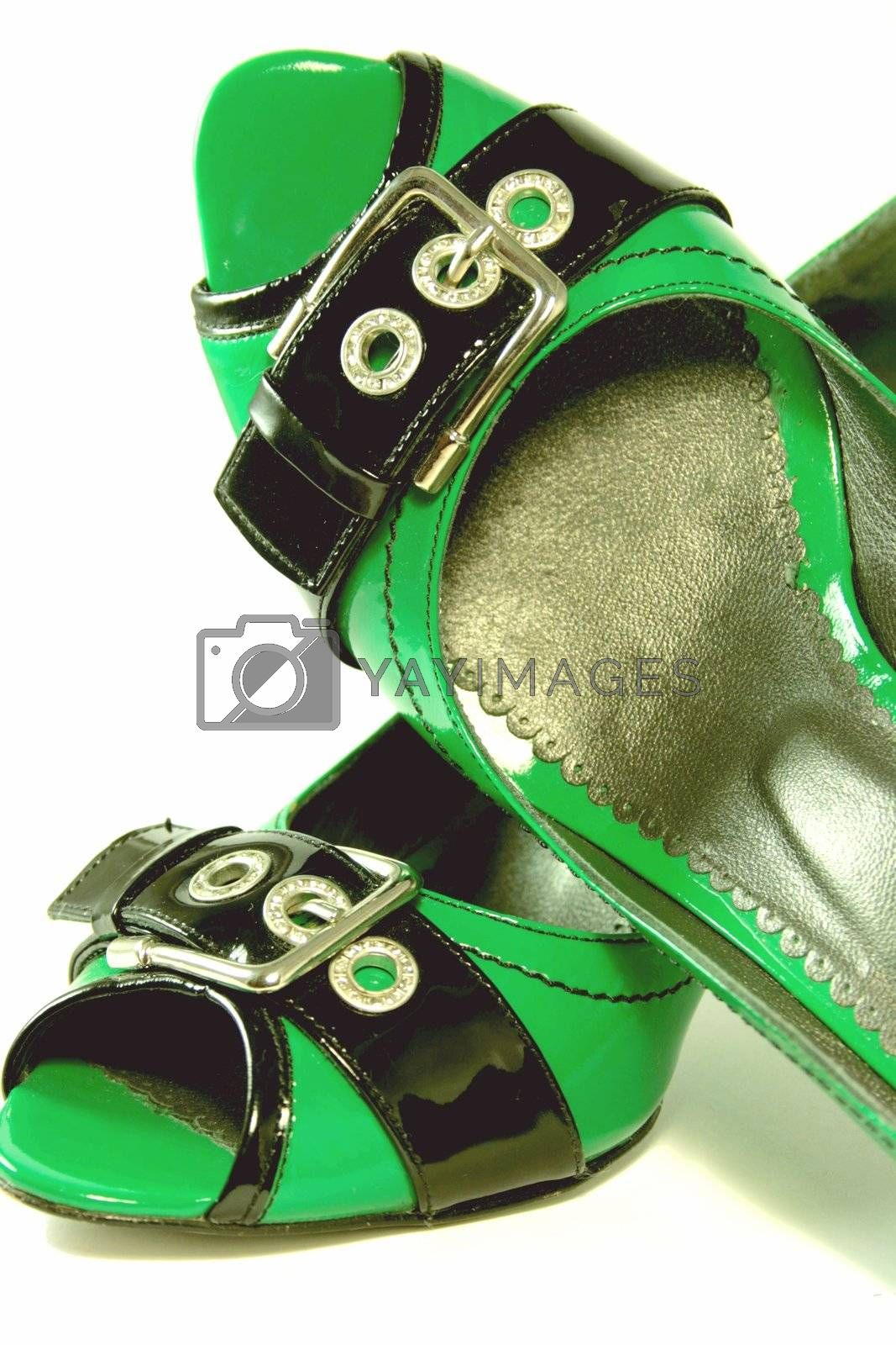 Green High-Heeled Shoes Close-up on white background. Series
