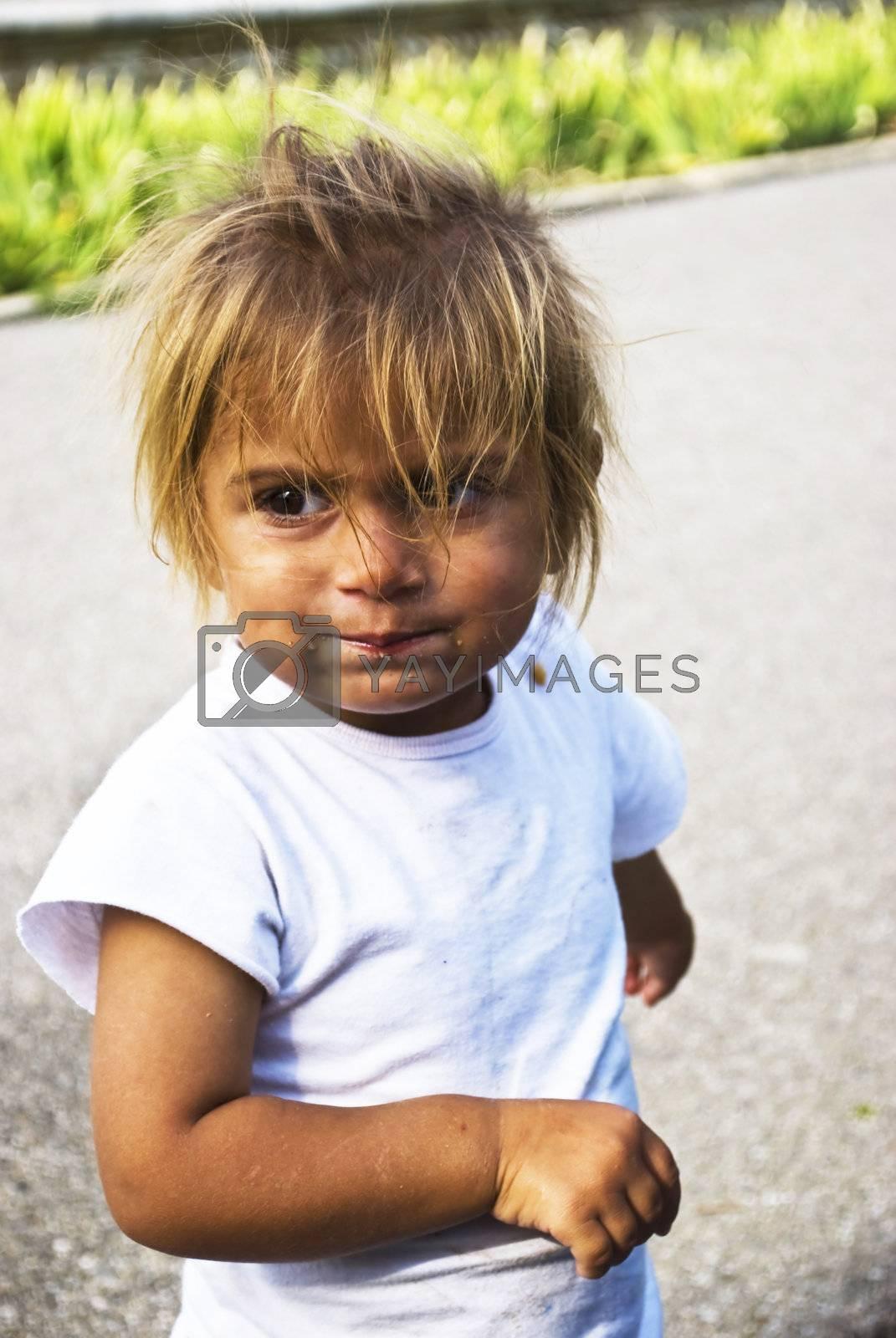 Royalty free image of beggar child by Dessie_bg