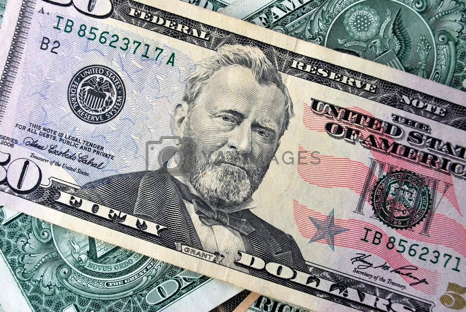 Royalty free image of 50 us dollars by Skovoroda