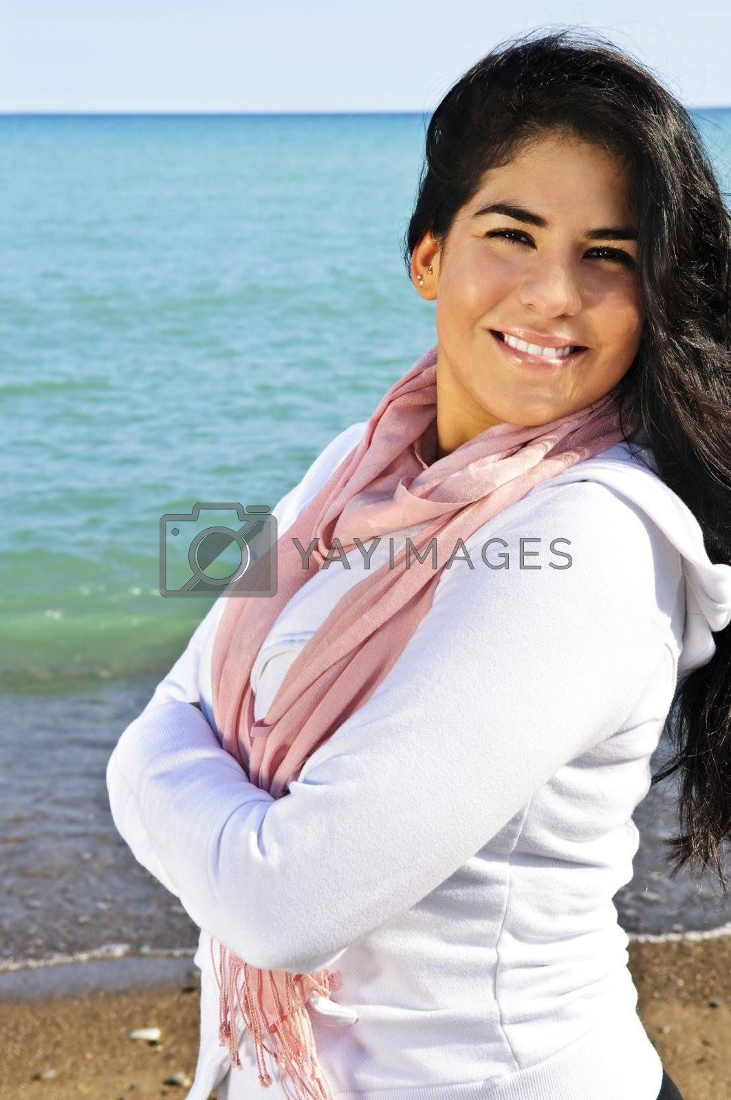 Royalty free image of Beautiful young woman at beach by elenathewise