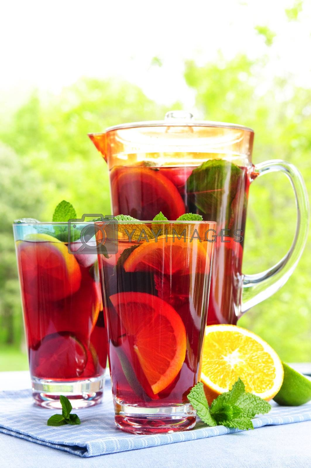 Royalty free image of Fruit punch in pitcher and glasses by elenathewise