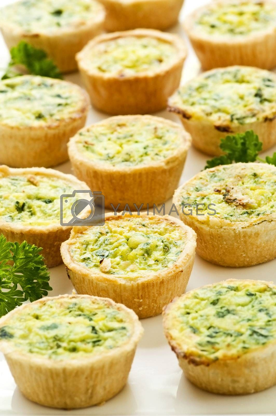 Royalty free image of Mini quiches by elenathewise