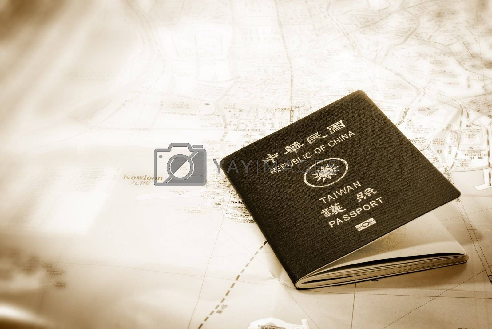 Royalty free image of taiwan passport on a map by elwynn