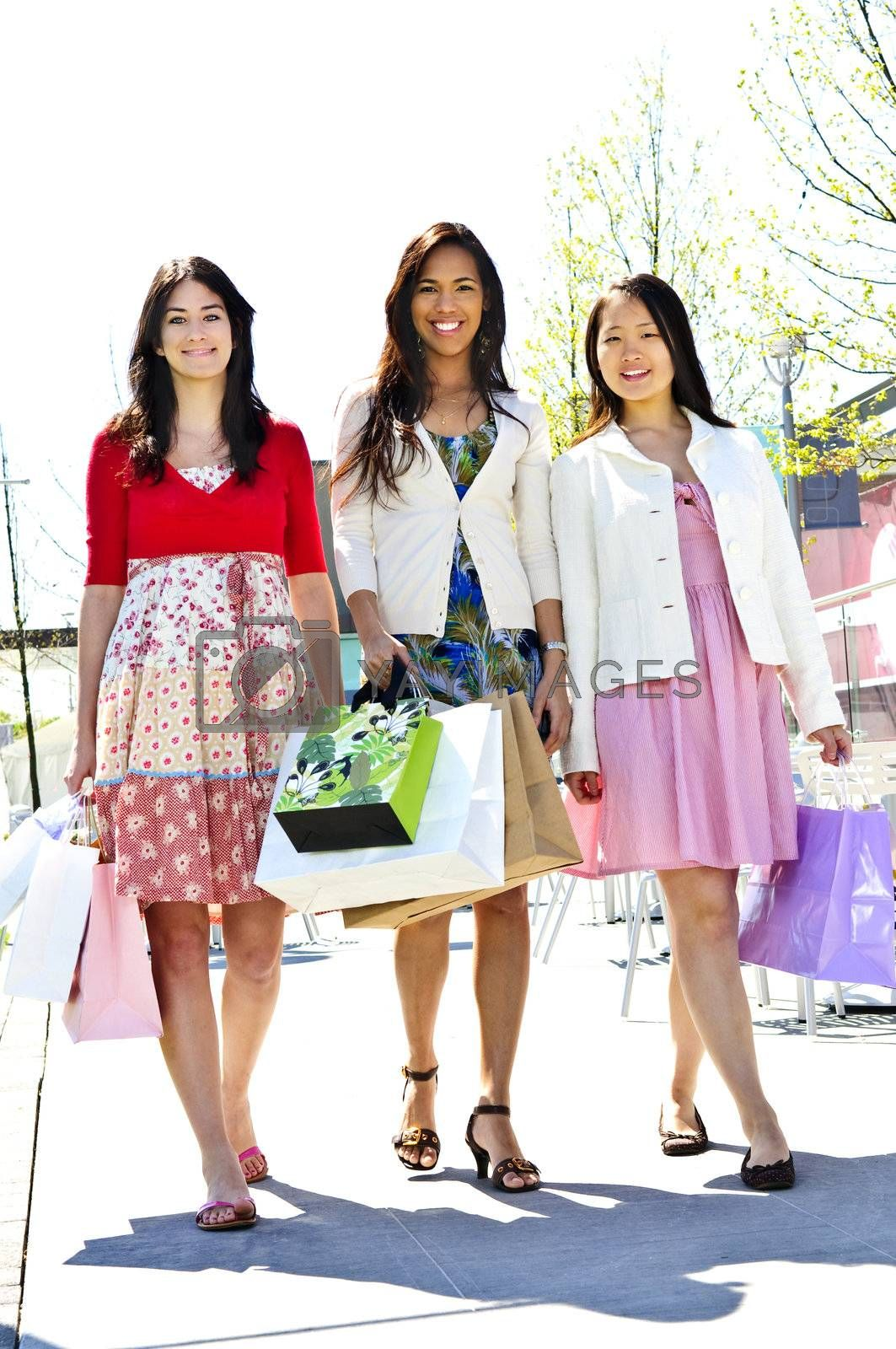 Royalty free image of Young girlfriends shopping by elenathewise