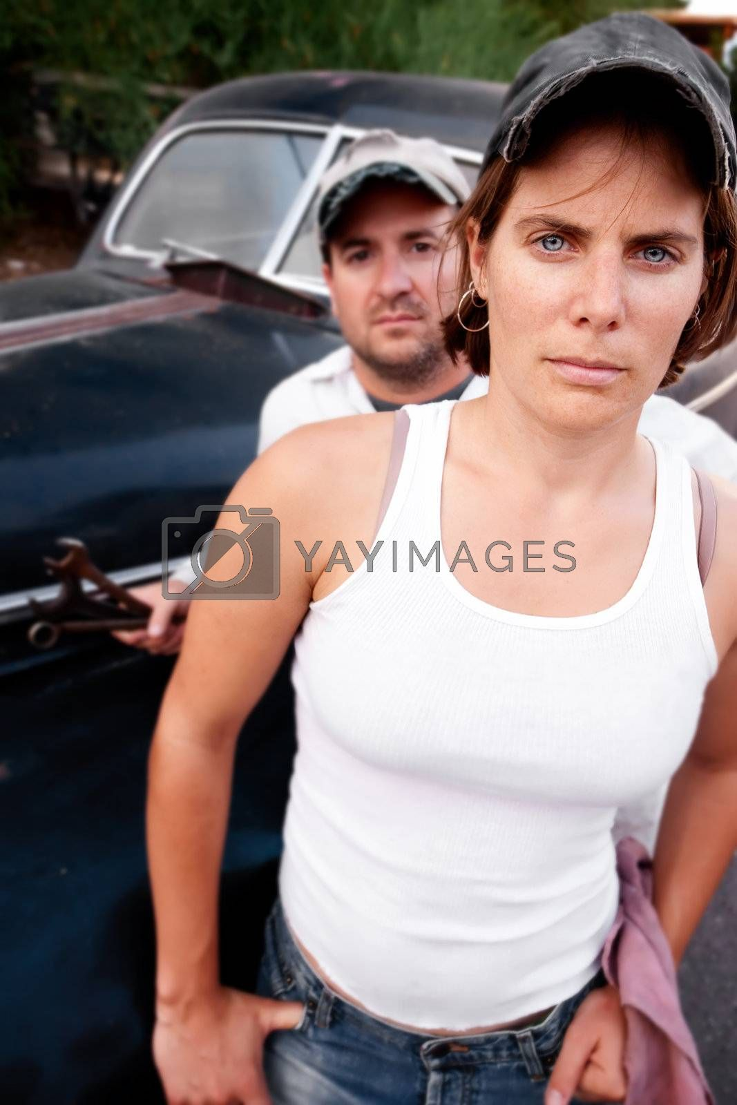 Royalty free image of Couple with Vintage Car by Creatista