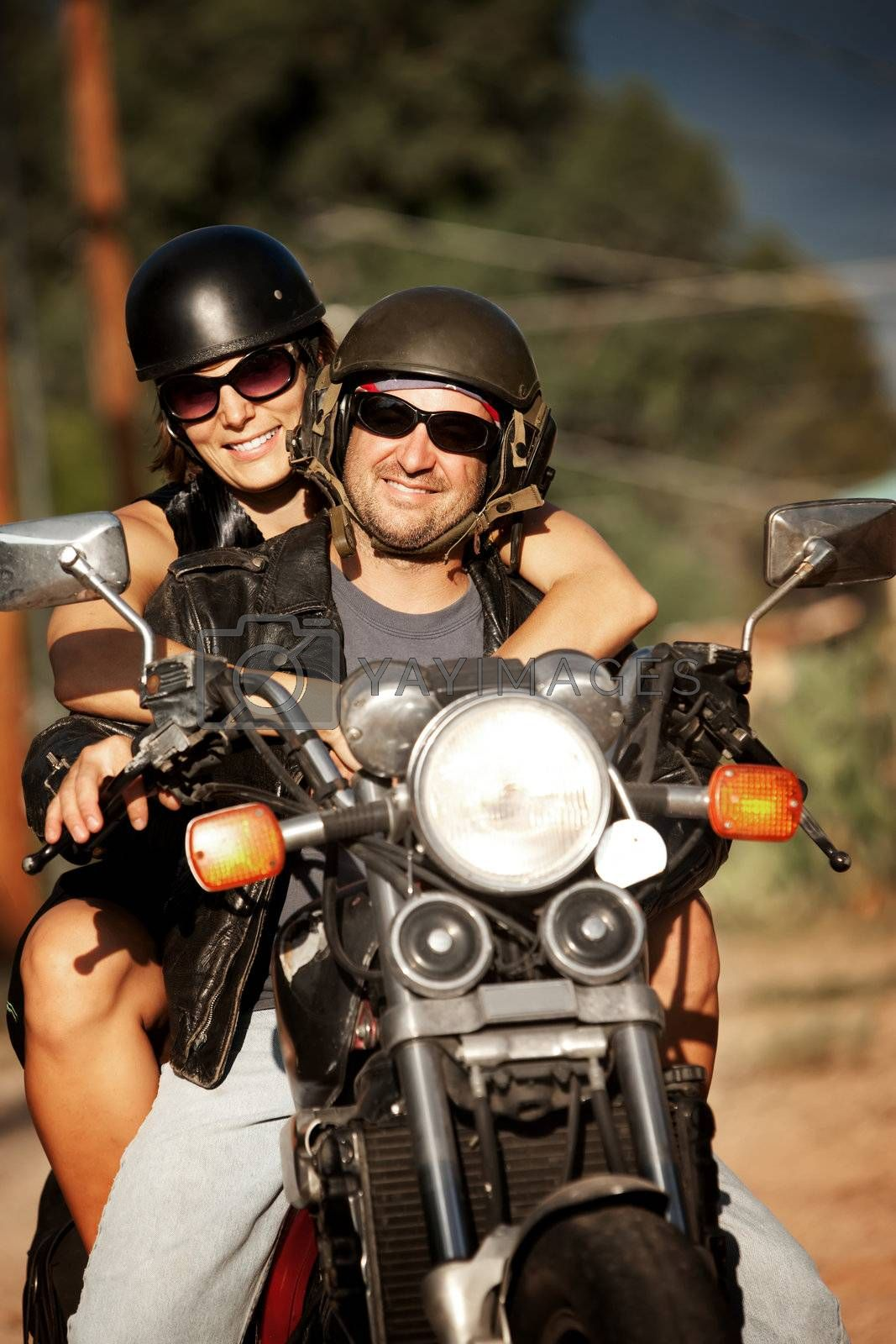 Royalty free image of Man and Woman on Motorcycle by Creatista