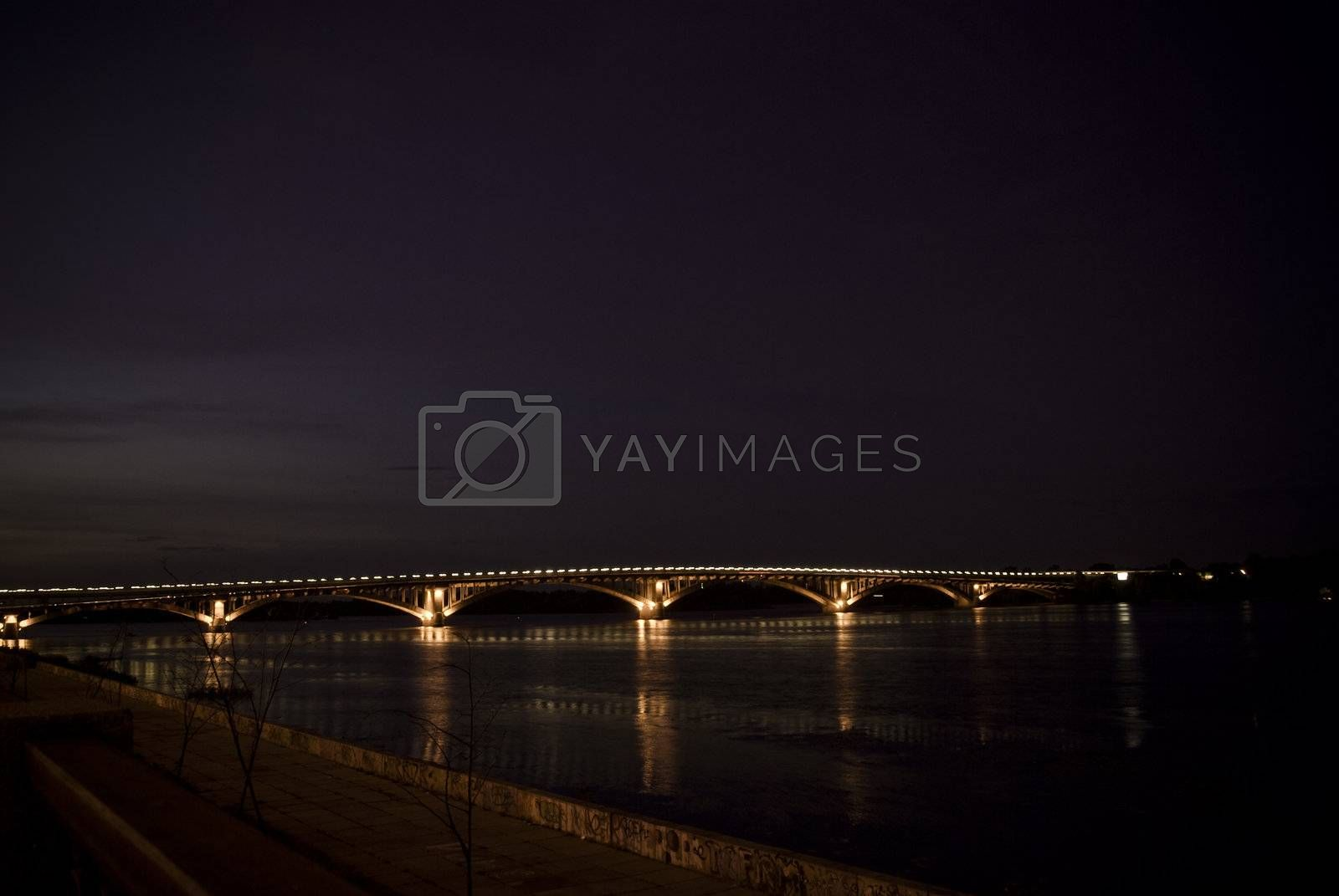 Royalty free image of The city bridge at night all on fires by jincomplete