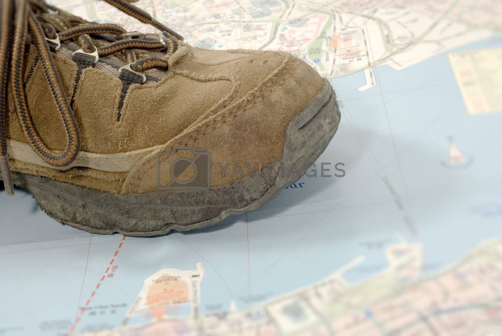 Royalty free image of old shoes traveling world alone by elwynn