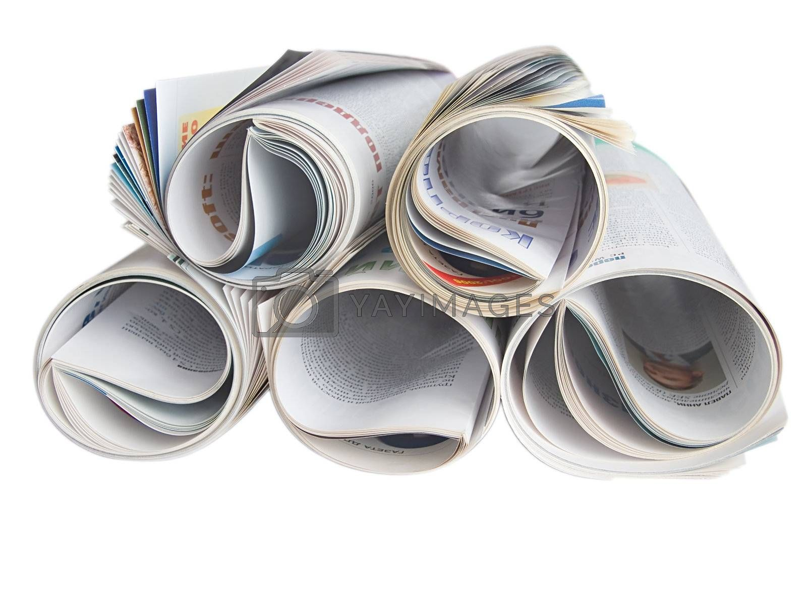 Royalty free image of Roll of newspaper isolated on white background by i9370