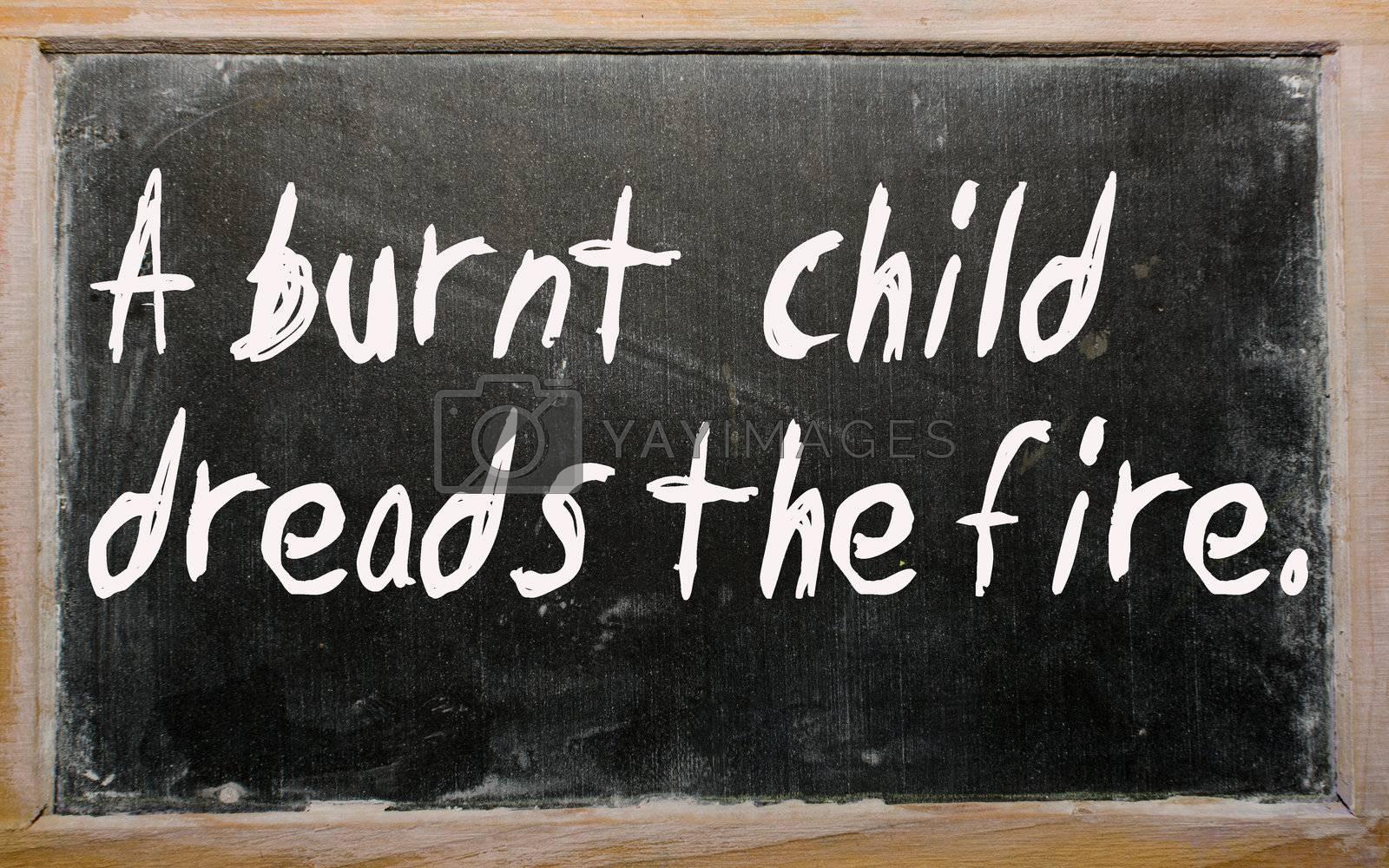 "Blackboard writings ""A burnt  child dreads the fire"""