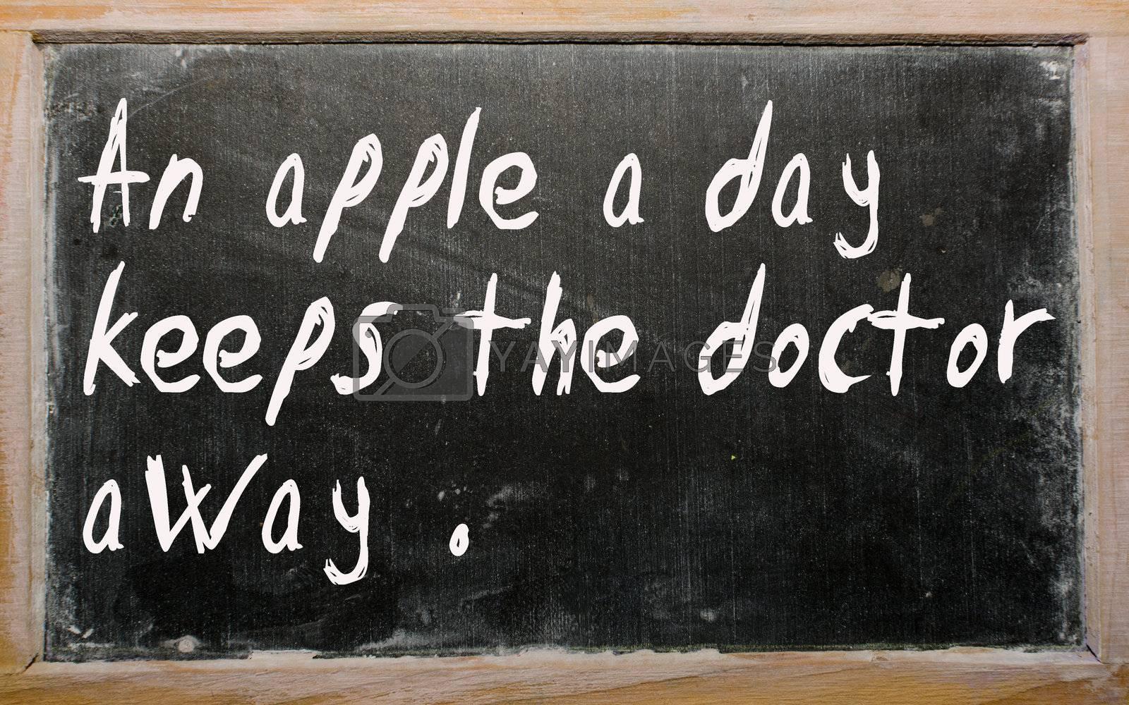 "Blackboard writings ""An apple a day keeps the doctor away"""
