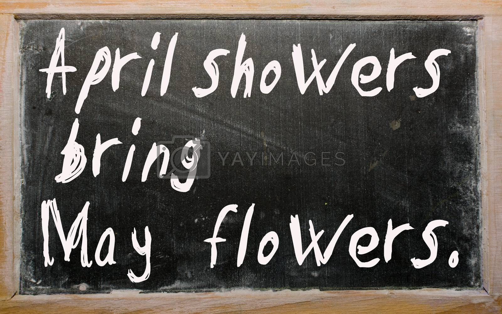 """Blackboard writings """"April showers bring May flowers"""""""